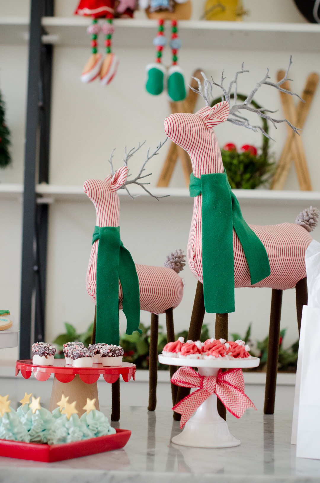 These red and white striped reindeer with the green scarves add the perfect vintage touches at this beautiful modern and vintage Christmas party. See more holiday party inspiration from Austin based party stylist Mint Event Design at www.minteventdesign.com #desserttable #christmasdesserts #holidayparty #holidays #partyideas #christmasparty #holidaypartyideas #reindeer