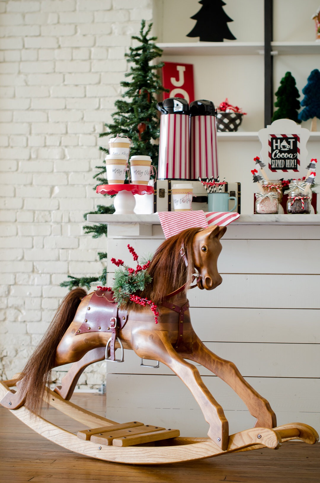 A hot cocoa station is perfect for any holiday party. And, when decorated with a vintage rocking horse in front, you know it's going to be fun. See more holiday party inspiration from Austin based party stylist Mint Event Design at www.minteventdesign.com #holidayparty #holidays #partyideas #christmasparty #holidaypartyideas #hotcocoabar #hotcocoa