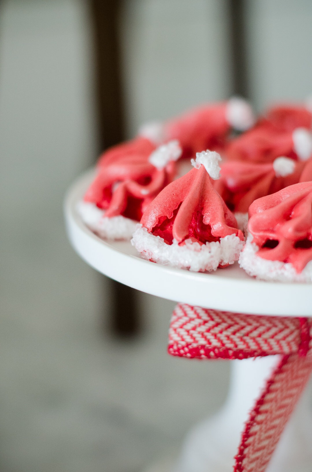 Santa hat petit fours are a perfect addition to your Christmas party. See more holiday party inspiration from Austin based party stylist Mint Event Design at www.minteventdesign.com #desserttable #christmasdesserts #holidayparty #holidays #partyideas #christmasparty #holidaypartyideas #petitfours