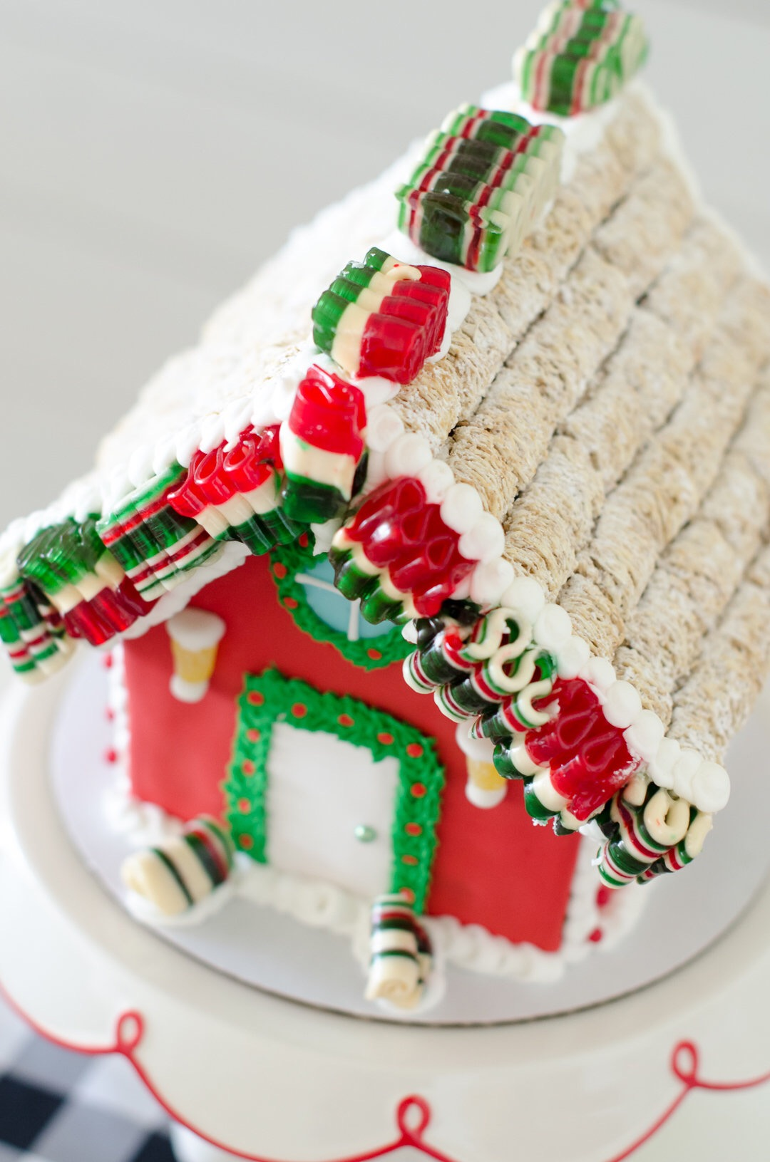 Beautifully decorated gingerbread house with ribbon candy. See more holiday party inspiration from Austin based party stylist Mint Event Design at www.minteventdesign.com #desserttable #christmasdesserts #holidayparty #holidays #partyideas #christmasparty #holidaypartyideas #gingerbreadhouses