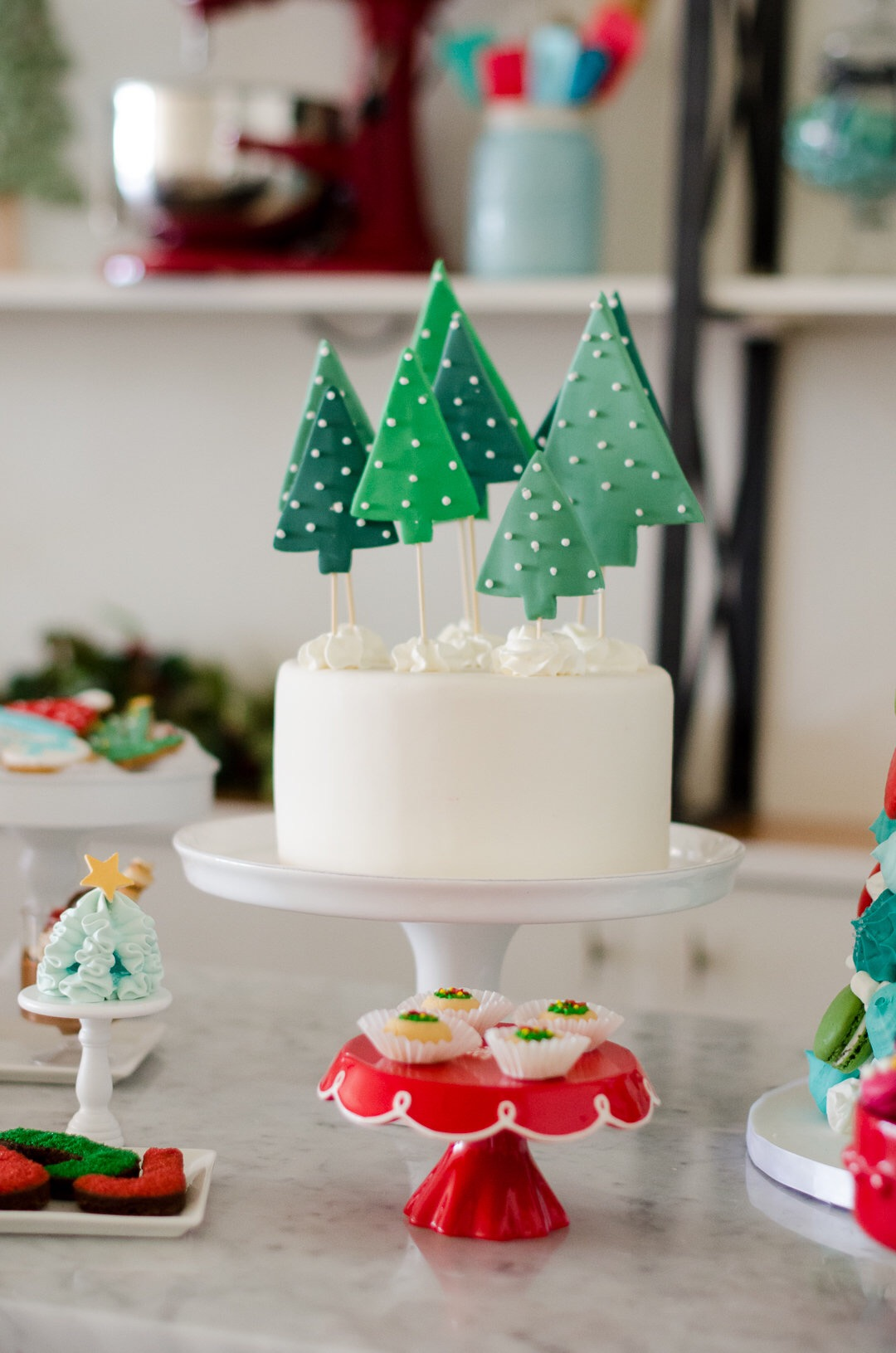You can never have too many desserts at a Holiday party, can you? This whole party is beautiful! Love the tree toppers on the cake. See more holiday party inspiration from Austin based party stylist Mint Event Design at www.minteventdesign.com #desserttable #christmasdesserts #holidayparty #holidays #partyideas #christmasparty #holidaypartyideas
