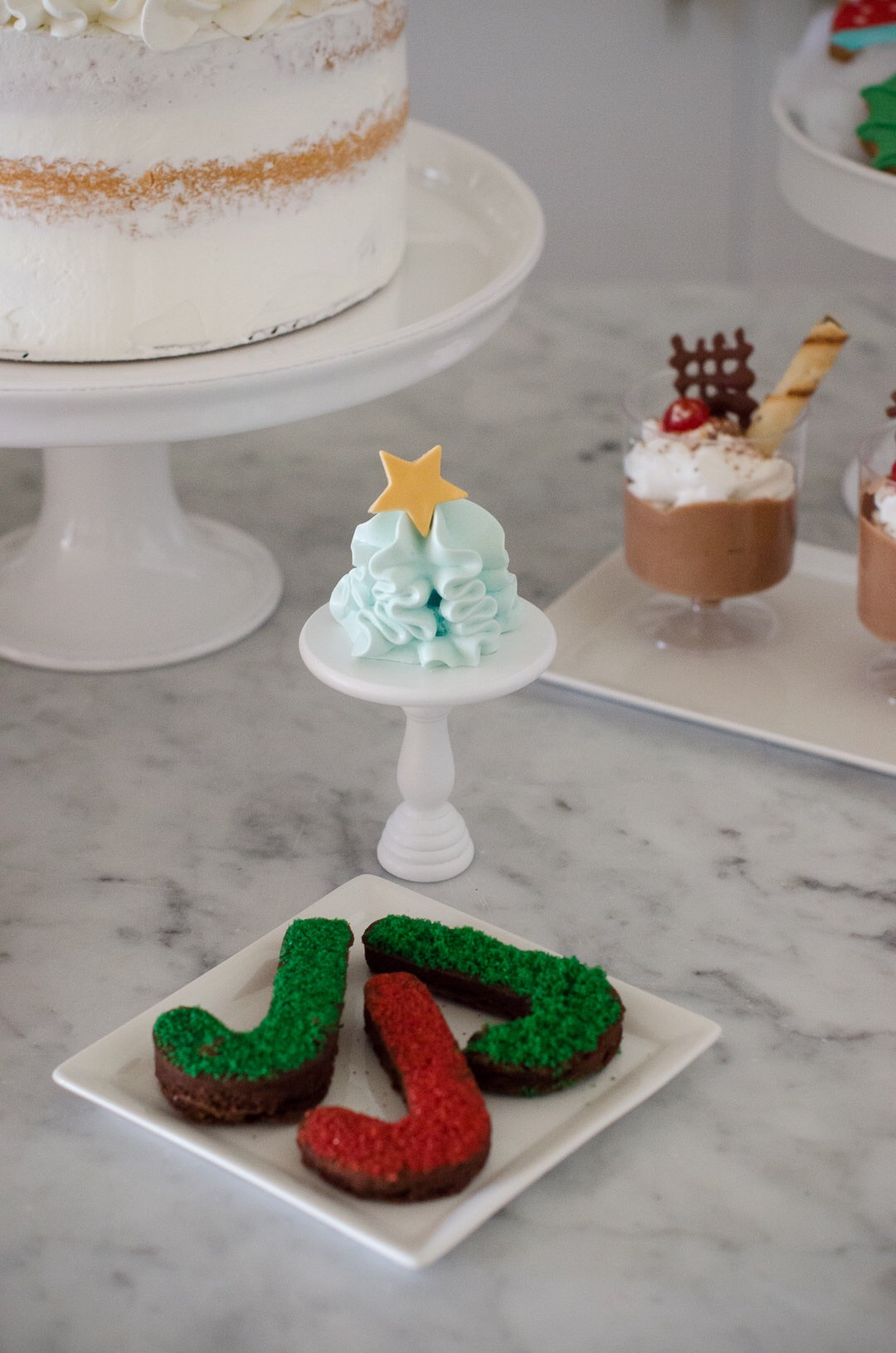 Brownies, meringues, and cakes - create a sweet display of Christmas desserts on a miniature size. See more holiday party inspiration from Austin based party stylist Mint Event Design at www.minteventdesign.com #desserttable #christmasdesserts #holidayparty #holidays #partyideas #christmasparty #holidaypartyideas