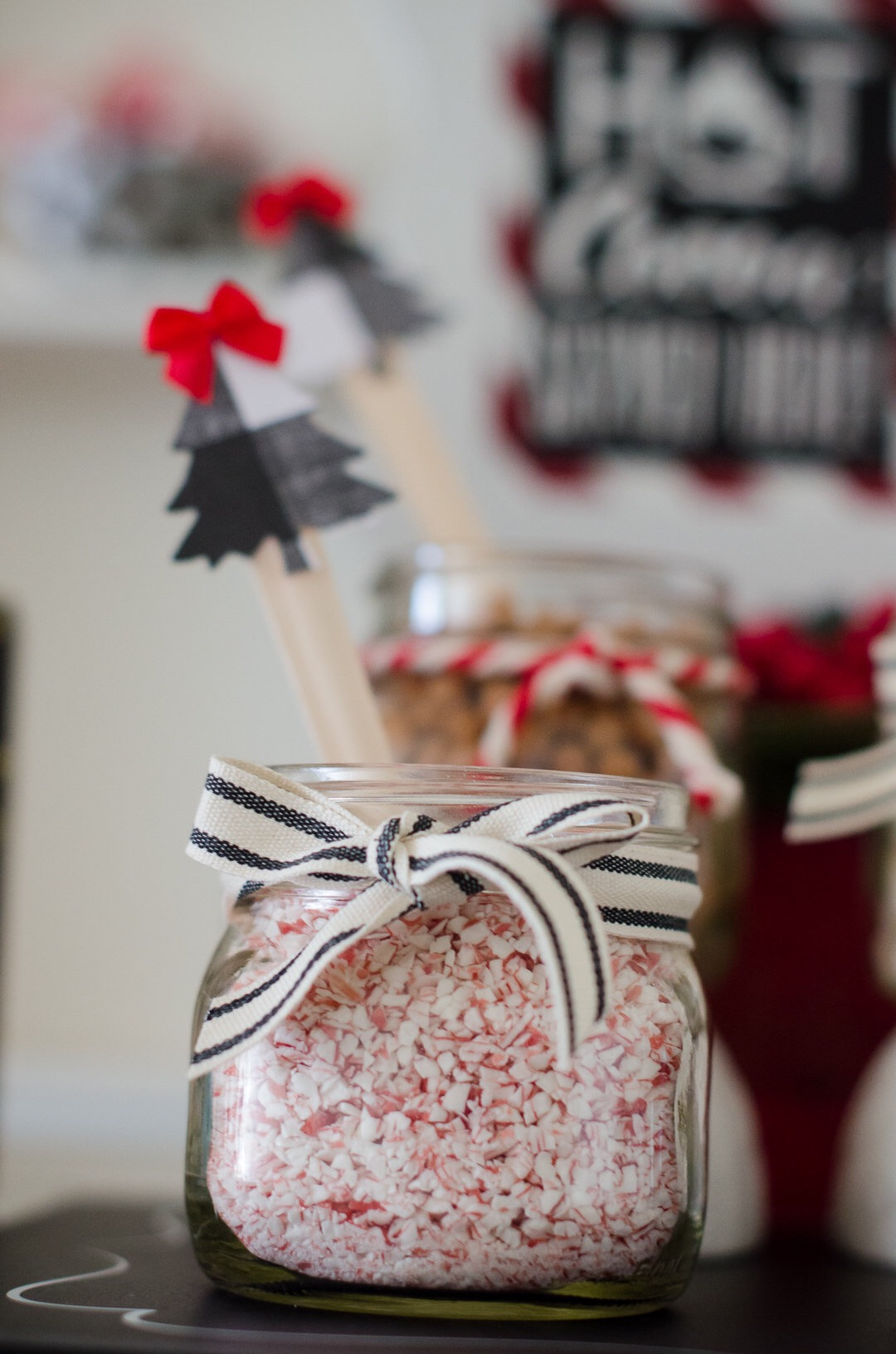 Peppermint toppings at a Christmas Hot Cocoa Station. Love the black and white ribbon tied around the mason jar. See more holiday party inspiration from Austin based party stylist Mint Event Design at www.minteventdesign.com #holidayparty #holidays #partyideas #christmasparty #holidaypartyideas #hotcocoabar #hotcocoa