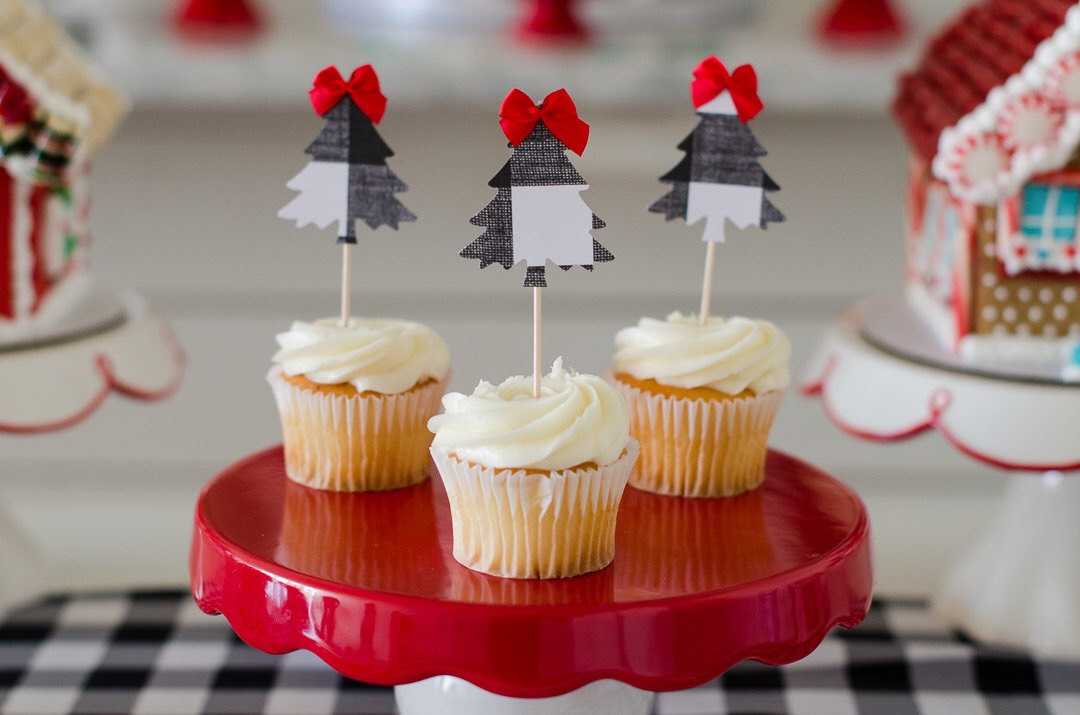 Vanilla cupcakes with buffalo plaid tree cupcake toppers. See more holiday party inspiration from Austin based party stylist Mint Event Design at www.minteventdesign.com #desserttable #cupcakes #christmasdesserts #holidayparty #holidays #partyideas #christmasparty #holidaypartyideas