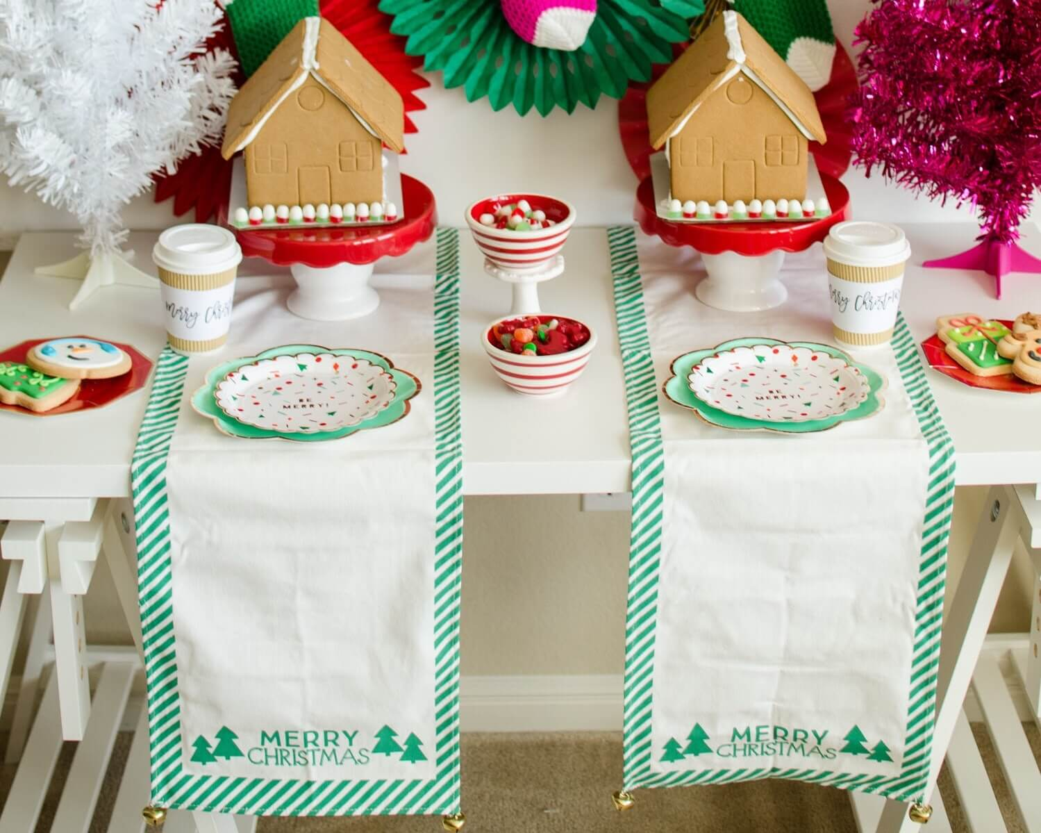 Gingerbread House Decorating Party Tip: Flip a table runner on it's side to create a workspace for each child. See more holiday decorating ideas for kids holiday parties on Mint Event Design www.minteventdesign.com #gingerbreadhouse #holidayparty #holidays #partyideas #christmasparty #holidaypartyideas #kidsparty