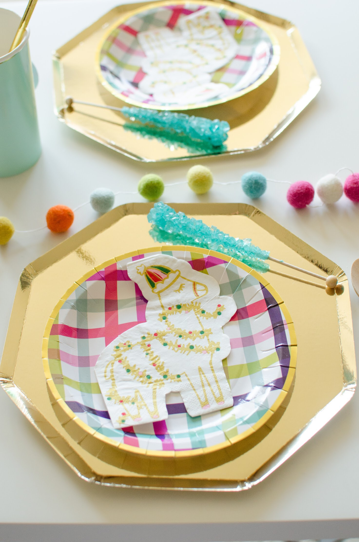 Such an adorable llama themed holiday party. This fa la la la llama party from Mint Event Design features fun plaid patterned plates in the party colors. See more from this modern llama party at www.minteventdesign.com #holidayparty #partyideas #christmasparty #holidaypartyideas #llamaparty #llamalove #tabledecorations