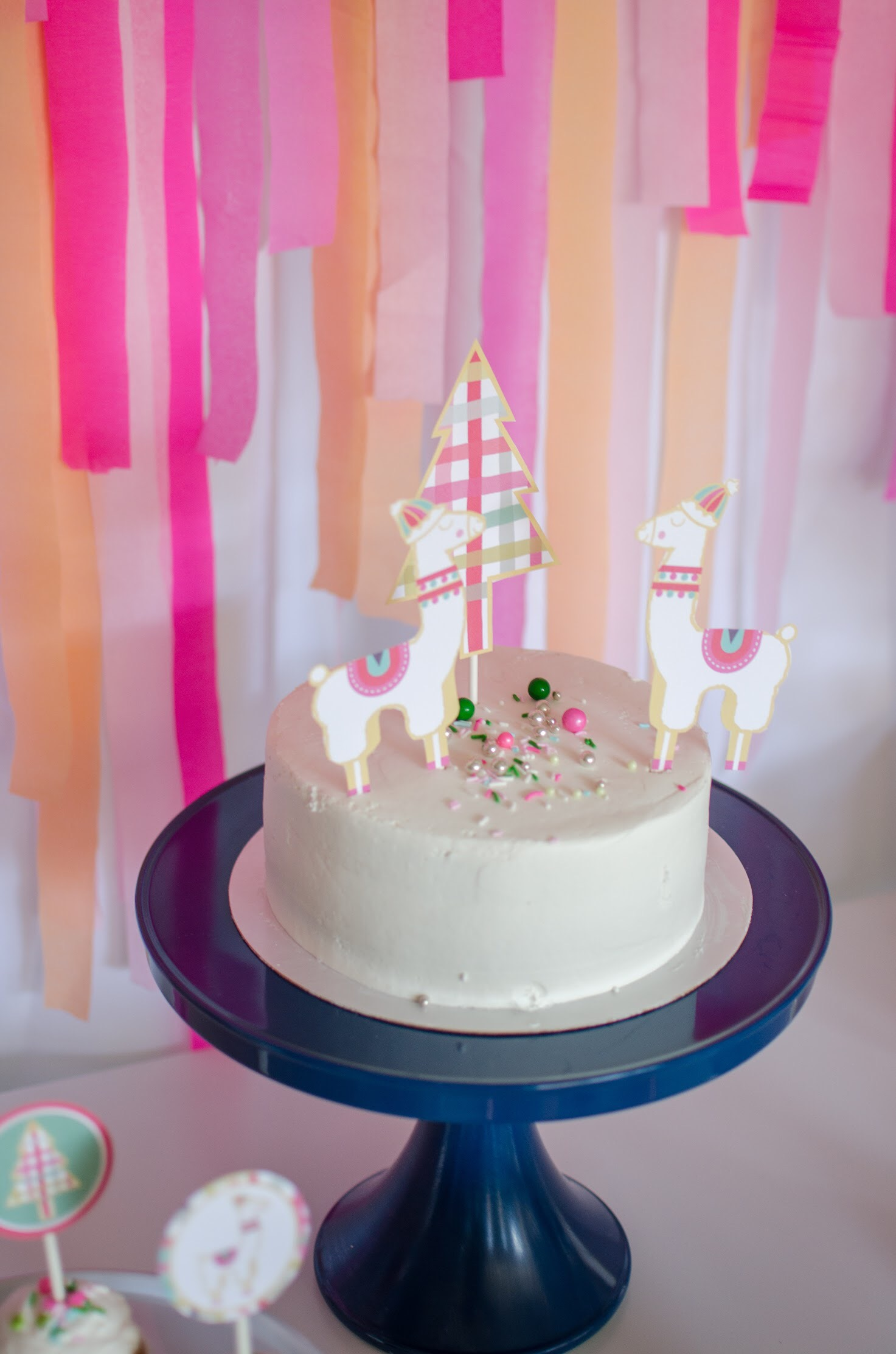 Christmas llama themed cake is perfect for your holiday party. See more from this llama Christmas party by Mint Event Design at www.minteventdesign.com and download your free printables #holidayparty #partyideas #christmasparty #holidaypartyideas #llamaparty #llamalove #partyprintables #freeprintables
