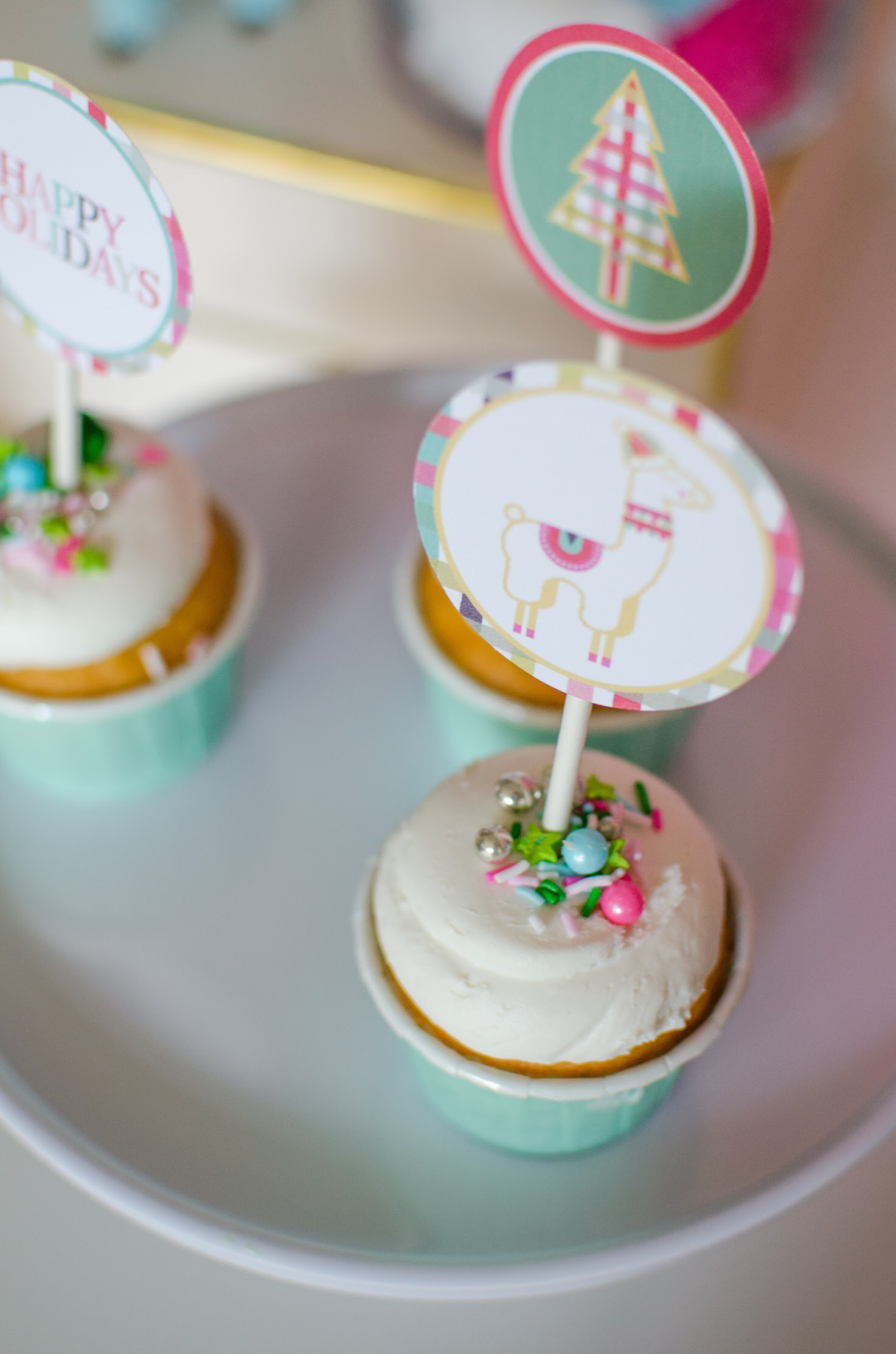 This cute fa la la la llama cupcake topper is a free download from Mint Event Design. See more from this llama Christmas party at www.minteventdesign.com and download your free printables #holidayparty #partyideas #christmasparty #holidaypartyideas #llamaparty #llamalove #partyprintables #freeprintables