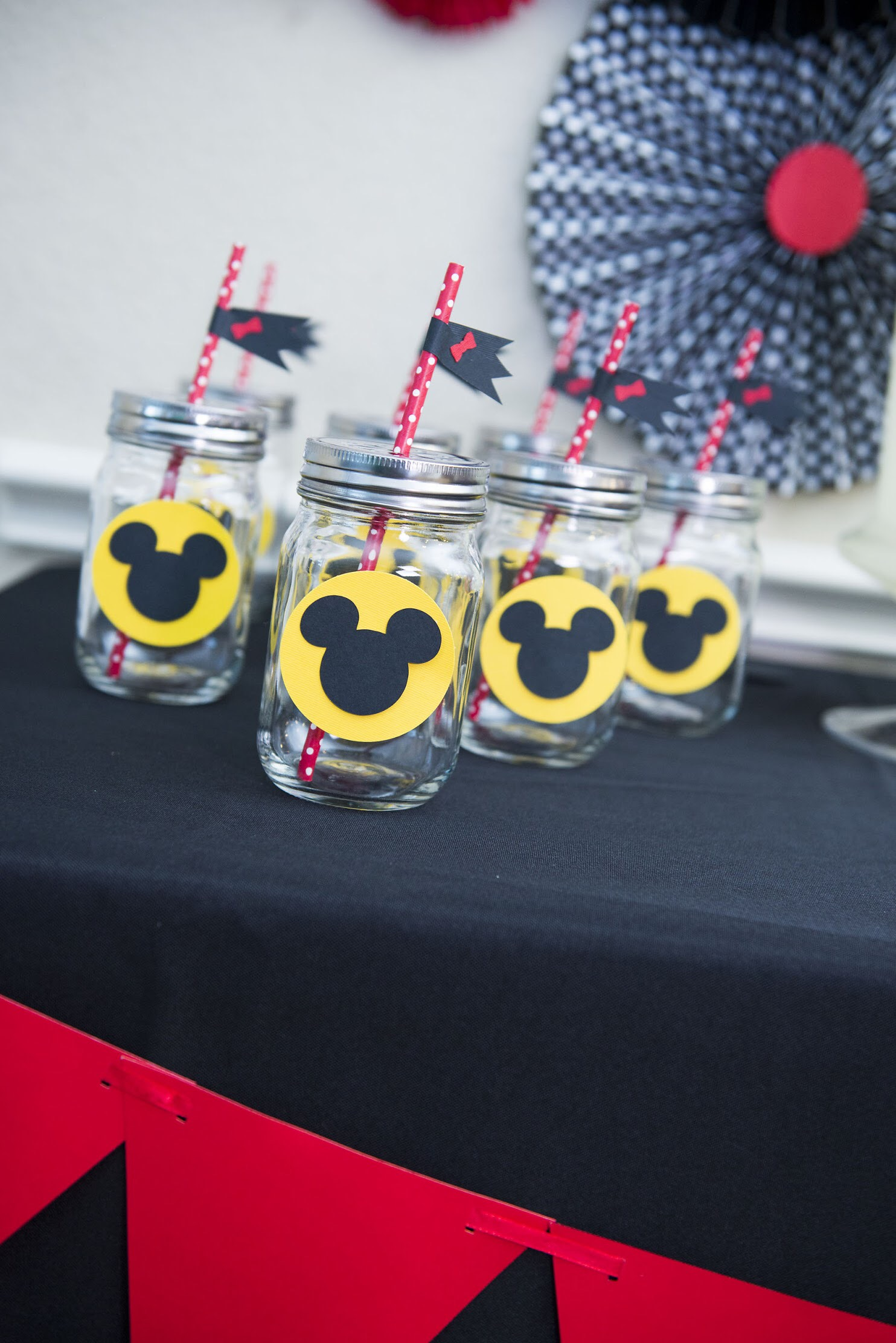 Cute Mickey Cut Outs on these Mason Jars, perfect for a Mickey Mouse party