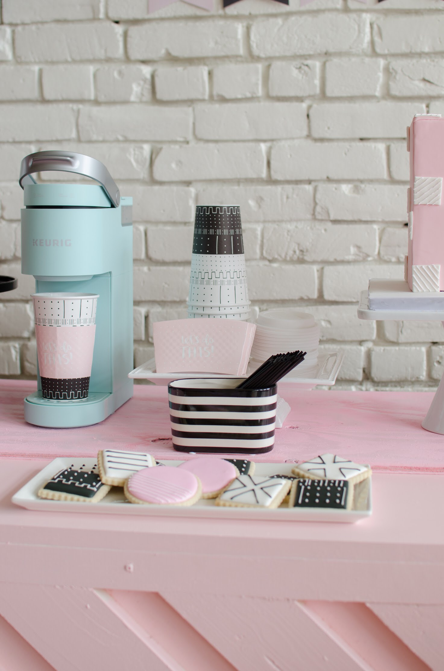 Cute coffee bar and cookies at a Galentine's Day party