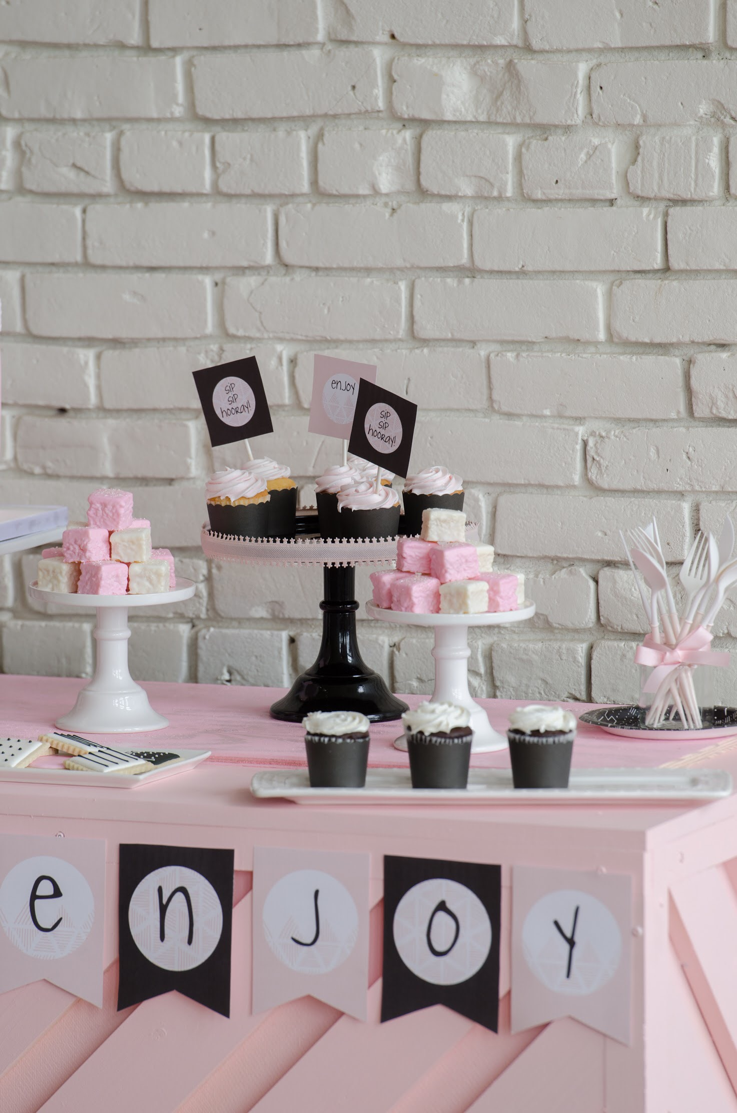 Cute cupcakes and petit four at this Galentine's Day Bash