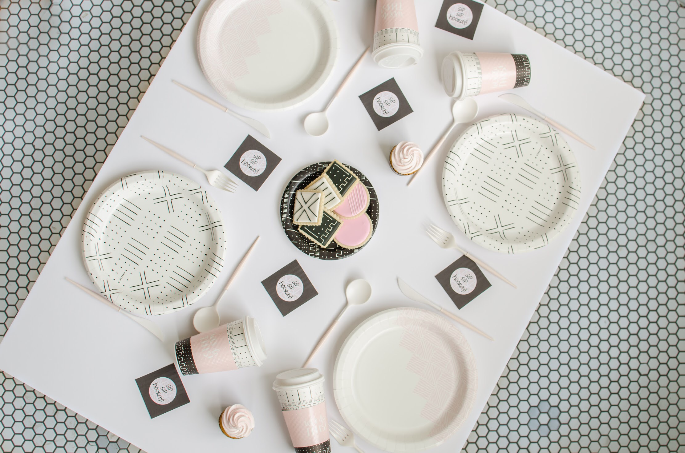Love this flatlay view of this mod party! Perfect color combo of pink black and white!