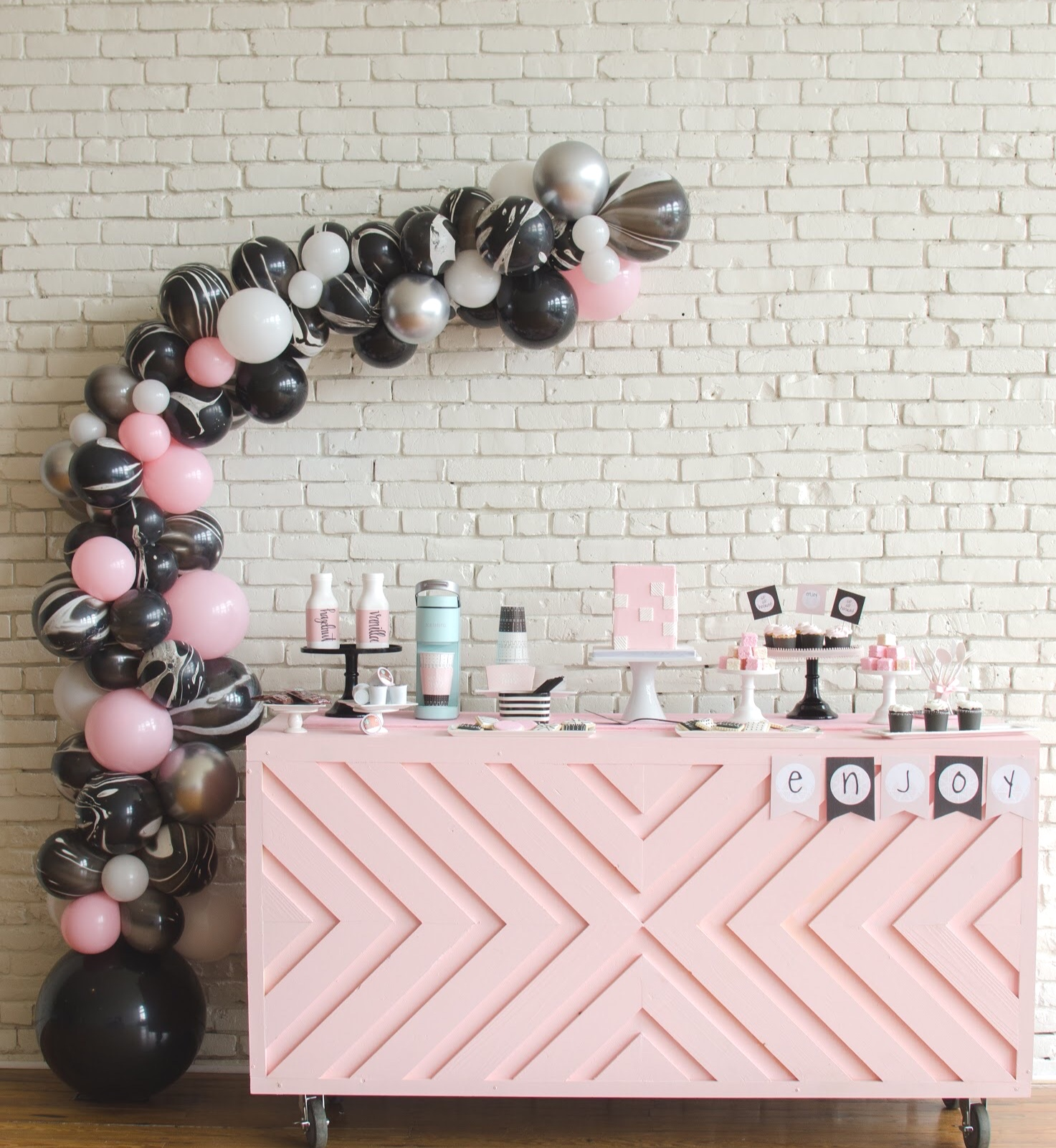 Beautiful balloon garland at this pink Galentine's Day party, would also be great for a baby/bridal shower!