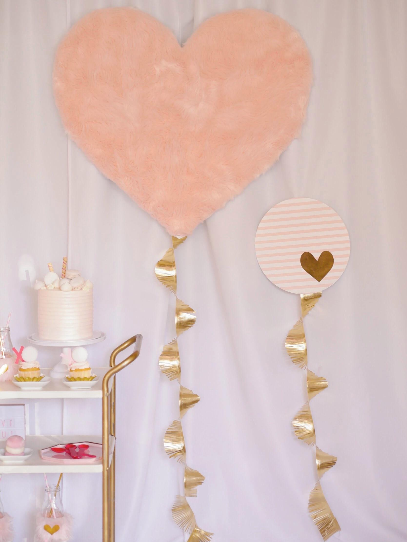 Homemade backdrop and adorable dessert cart idea