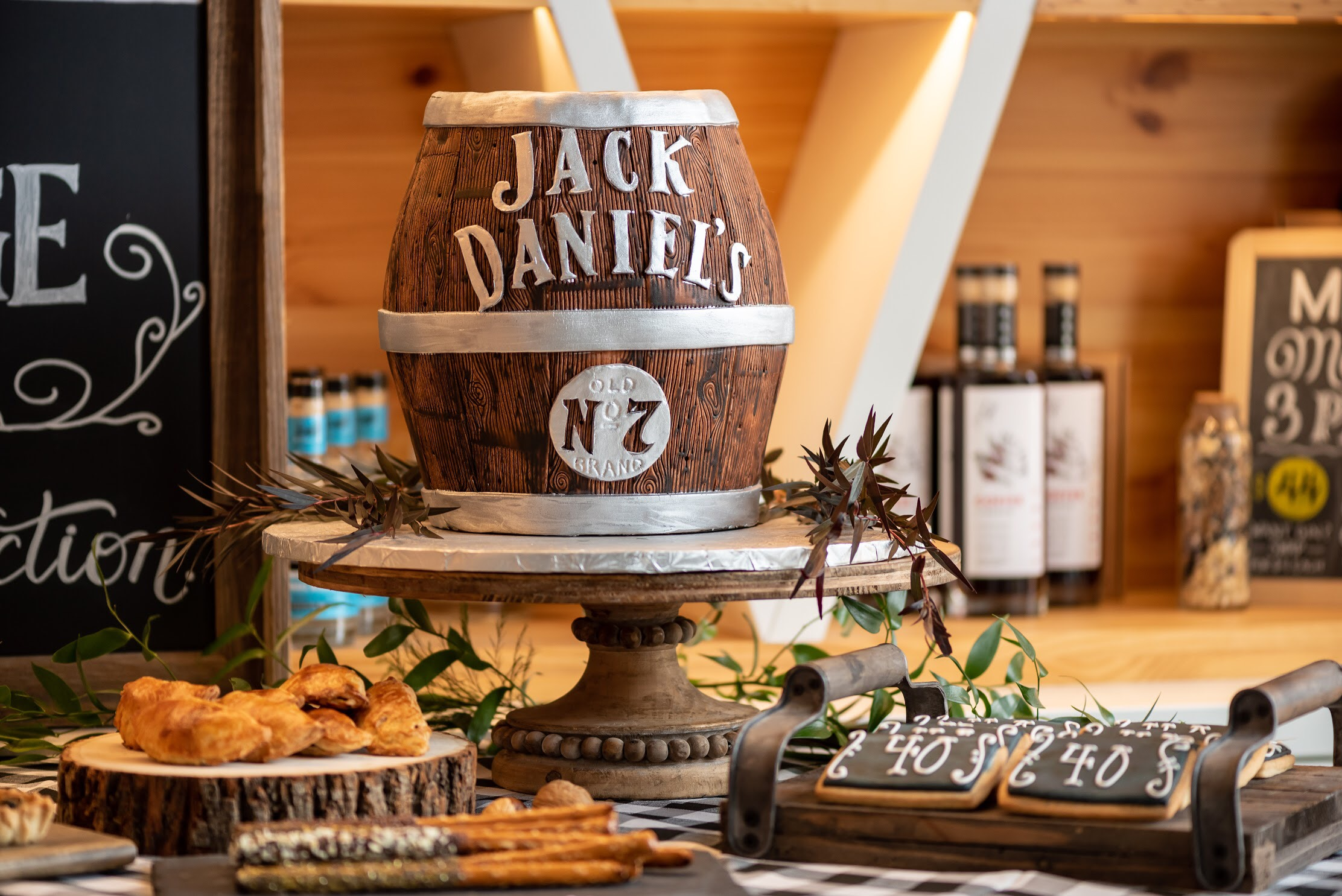 Love this Jack Daniel's barrel shaped cake and this whole party from Mint Event Design!