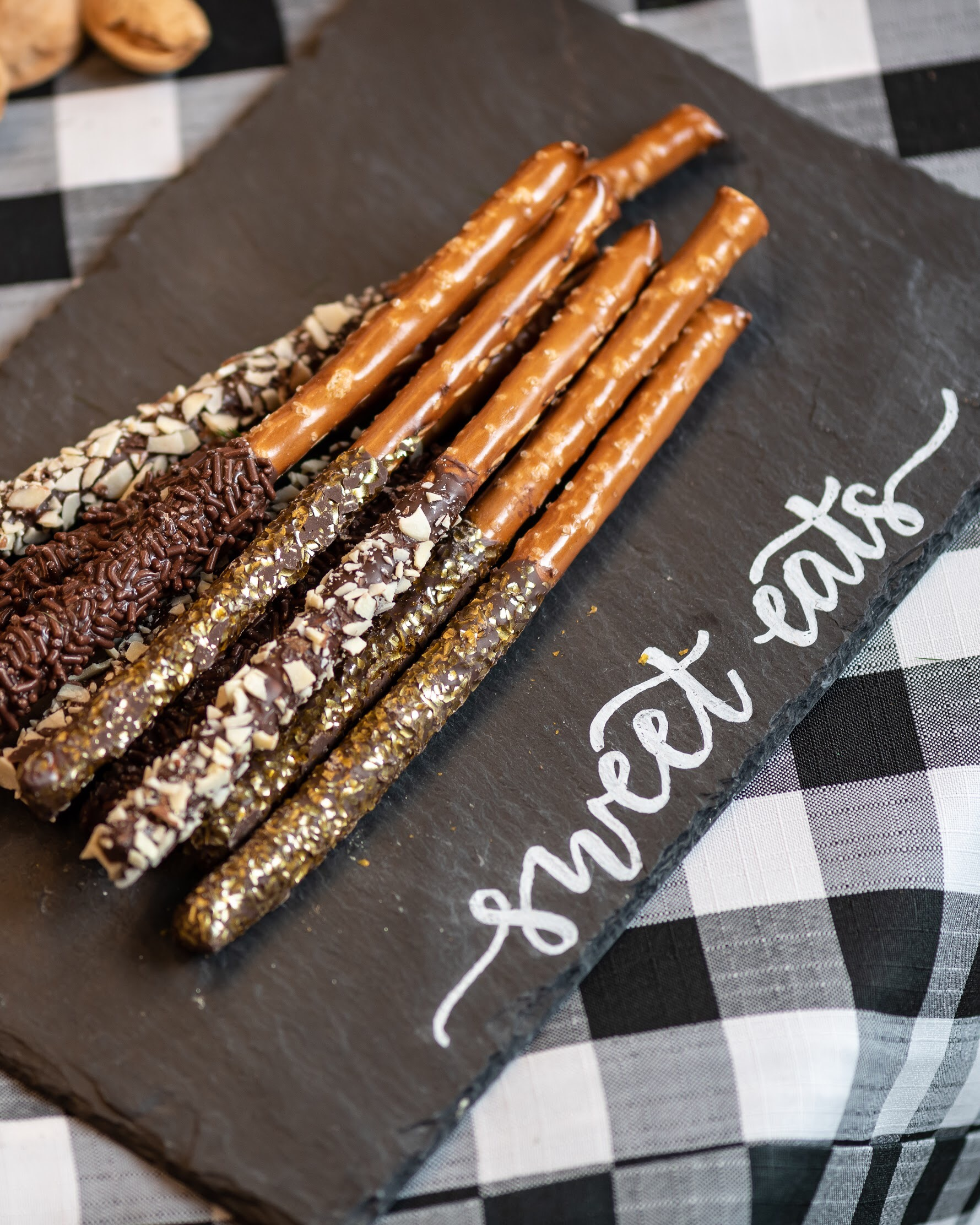 Chocolate covered pretzel rods are a welcome treat at any party! Love the use of the slate with hand lettered label