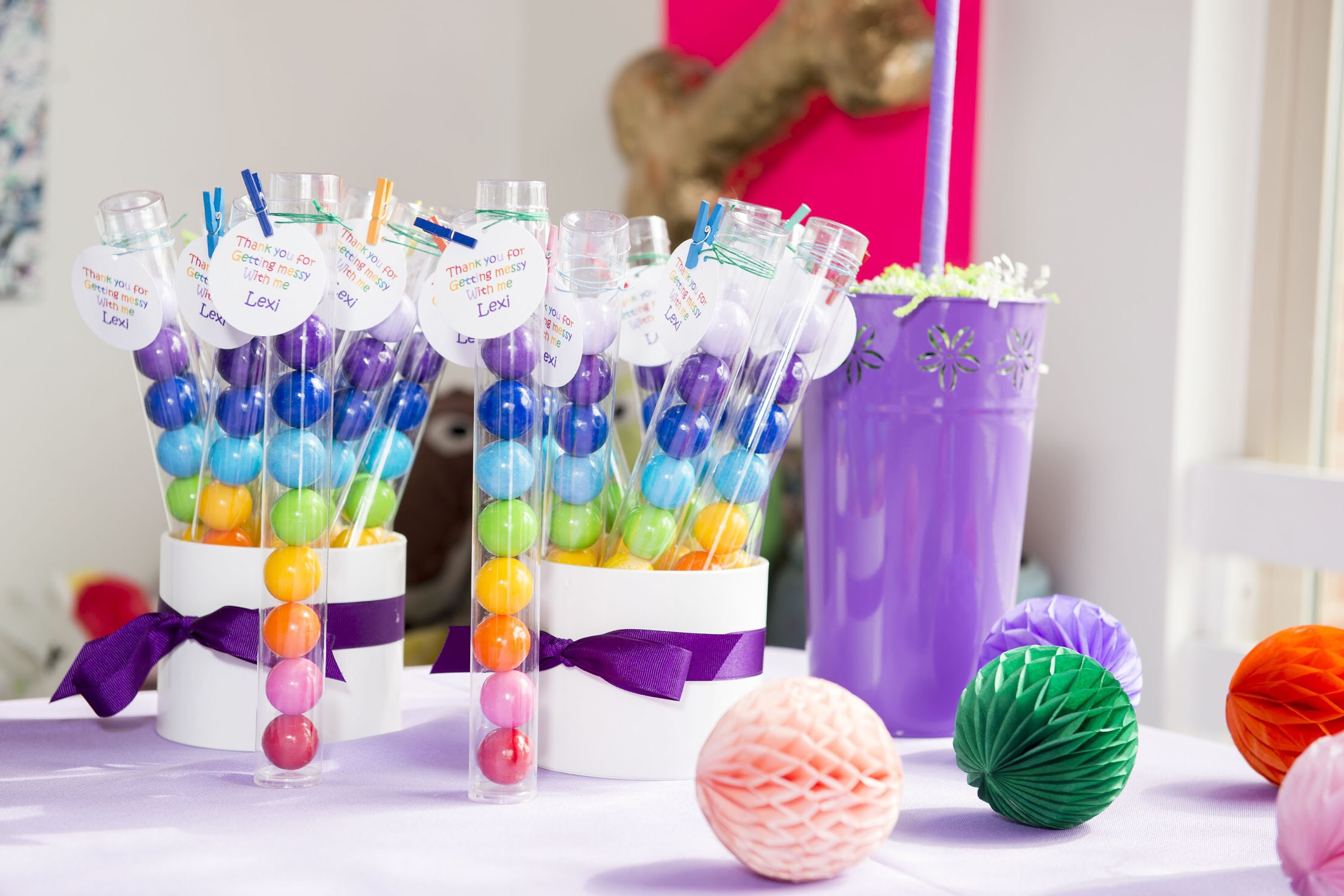 Cute gum ball tubes make a a great party favor for an art themed birthday party for kids. Click to see all the art themed party ideas on Mint Event Design www.minteventdesign.com #kidsparty #kidspartyideas #birthdaypartyideas #artparty #rainbowparty