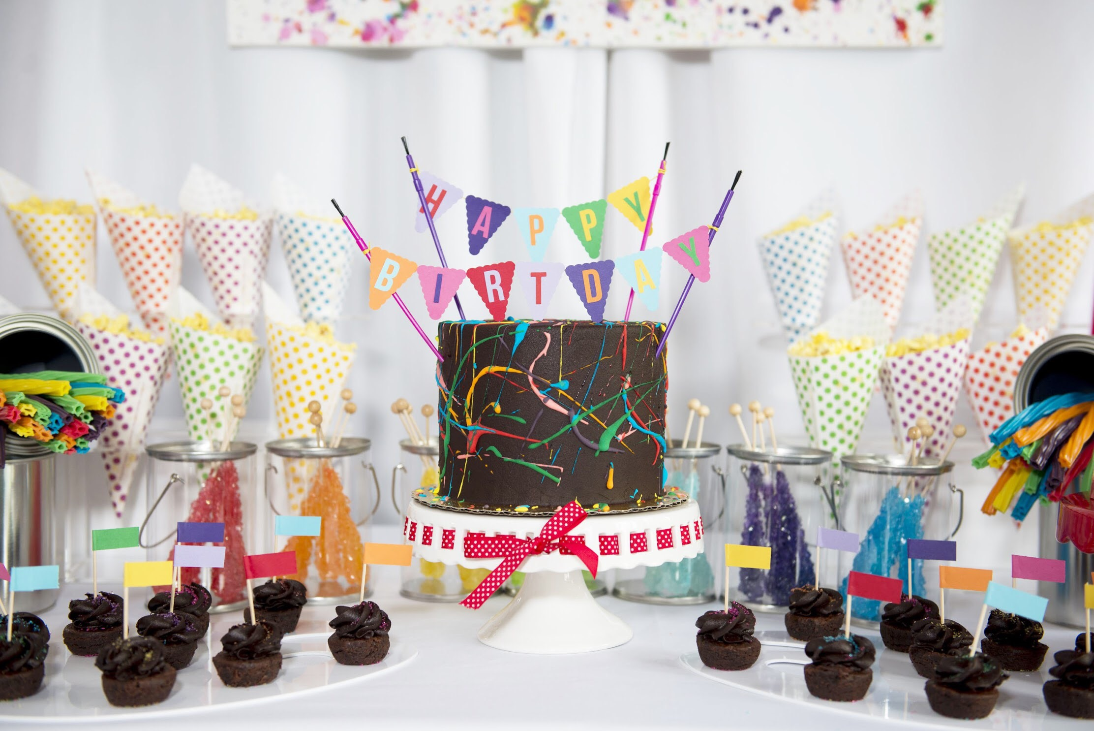 Art Themed Birthday Party Desserts: Chocolate brownie cake with mini brownie bites. See all the details on how to plan your art party at a local art studio on Mint Event Design www.minteventdesign.com #kidsparty #kidspartyideas #birthdaypartyideas #artparty #rainbowparty #birthdaycake #partydessert