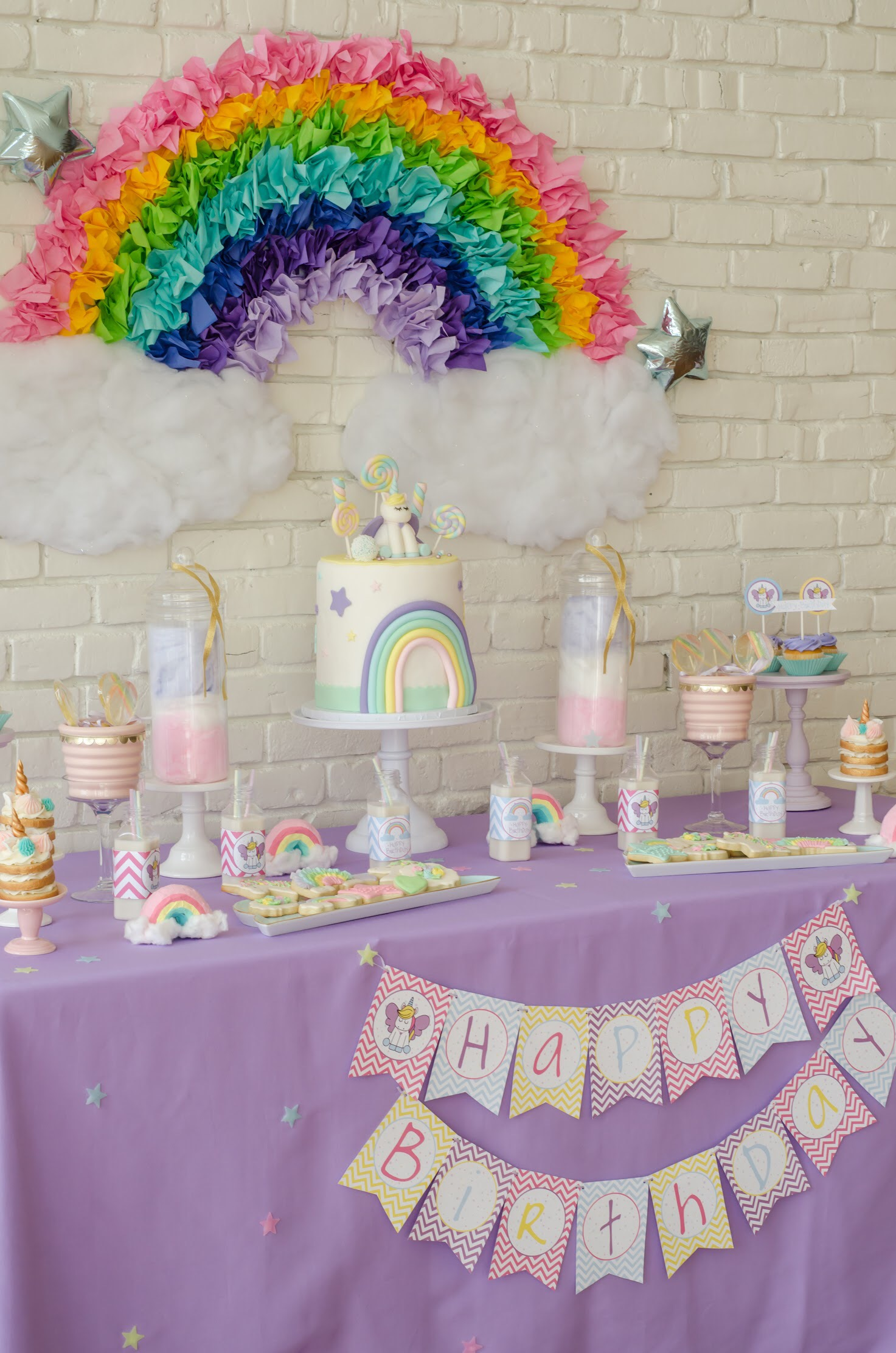 Love this rainbow colored unicorn party from Mint Event Design, perfect first birthday theme. Come see all the Unicorn Birthday Party Ideas at Mint Event Design www.minteventdesign.com #unicornparty #birthdayparty #birthdaypartyideas #pastelrainbow #desserttable