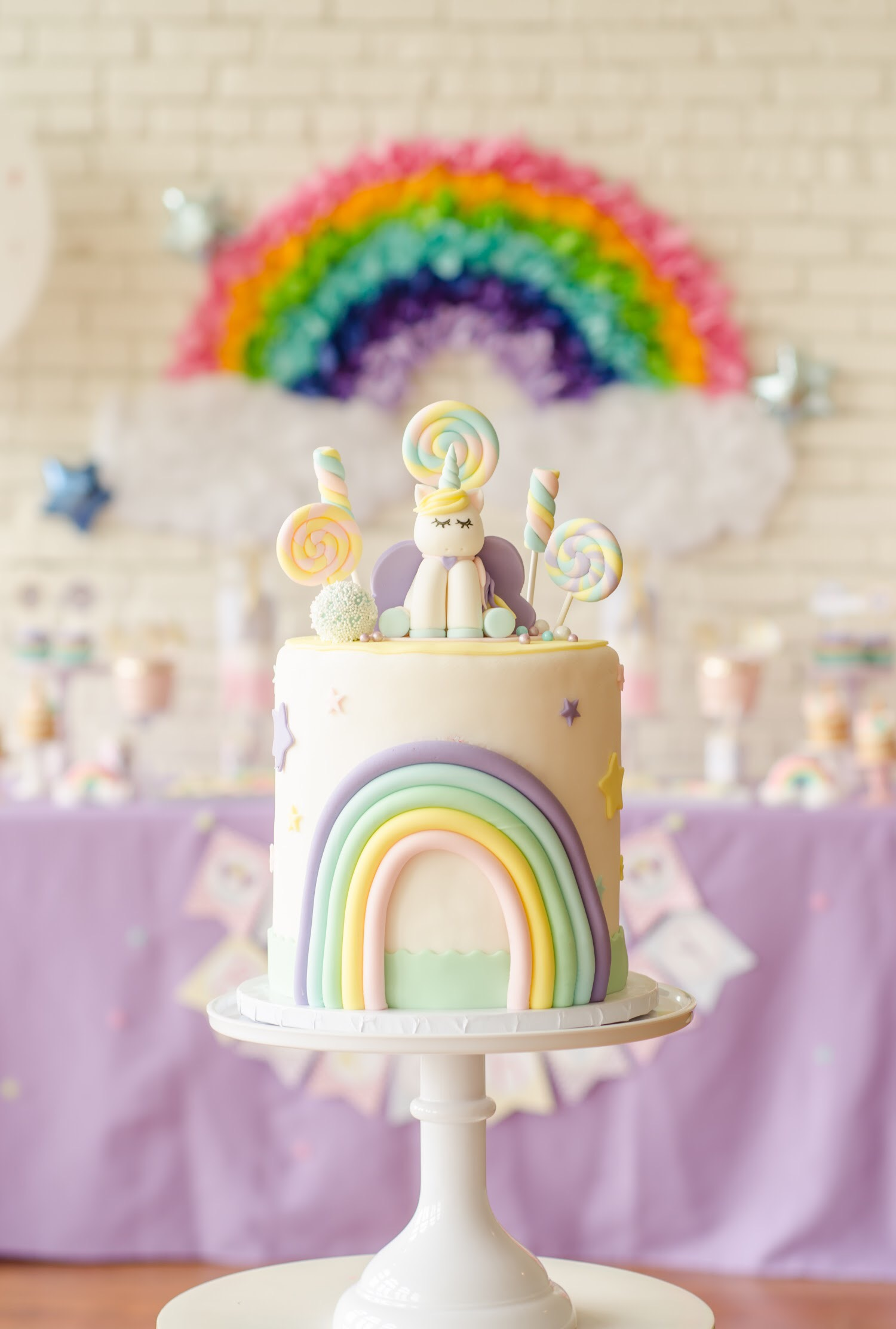 Super cute Unicorn birthday cake from Sweet Carousel Cakes. Come see all the cute Unicorn Birthday Party Ideas at Mint Event Design www.minteventdesign.com #unicornparty #birthdayparty #birthdaypartyideas #pastelrainbow #birthdaycake