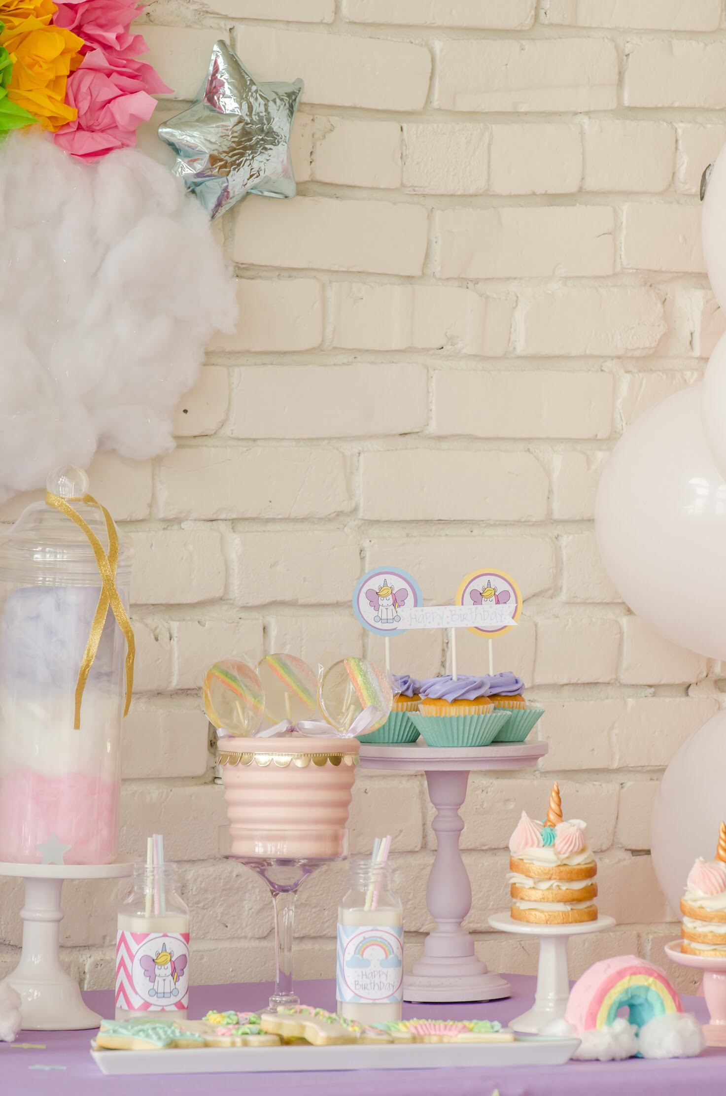 Unicorn themed birthday party dessert table from Mint Event Design www.minteventdesign.com #unicornparty #unicorncake #birthdayparty #birthdaypartyideas #birthdaydesserts #birthdaycake #desserttable