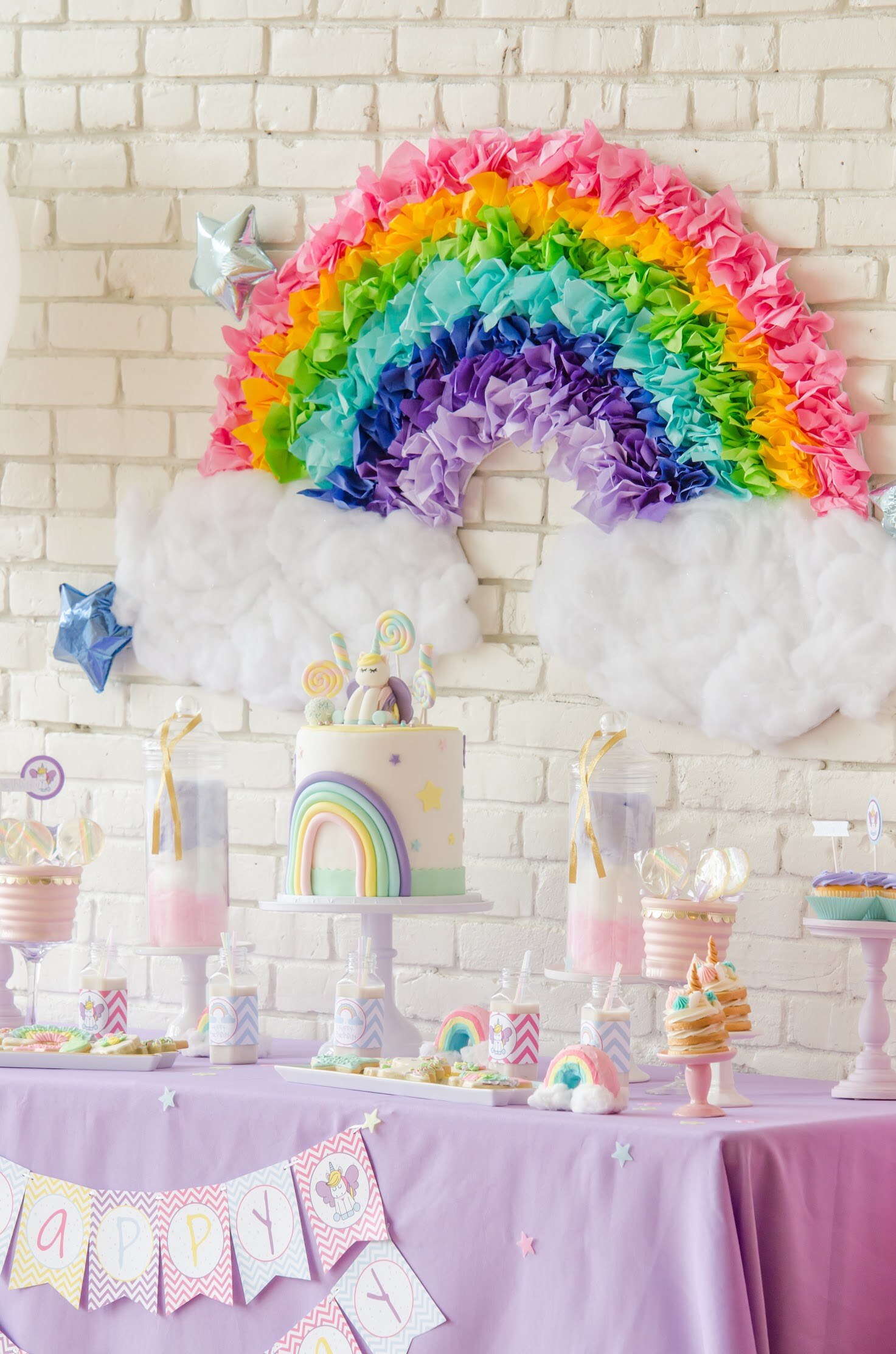 Sweet Pastel Unicorn Birthday Party ideas for girls including a DIY Rainbow Backdrop for your dessert table. Click for all the pastel rainbow party details from Mint Event Design www.minteventdesign.com #unicornparty #unicorndecor #unicorndecorations #pastelrainbow #birthdayparty #birthdaypartyideas
