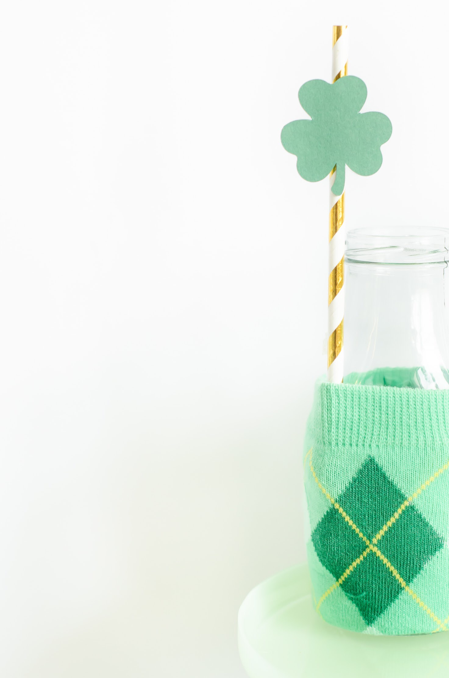 Repurpose holiday themed socks into cute milk jug wrappers for Saint Patricks Day - come see the full DIY on Mint Event Design www.minteventdesign.com #partyideas #partydecorations #saintpatricksday #stpatricksday #diycrafts #holidaycrafts #stpatricksdaycraft