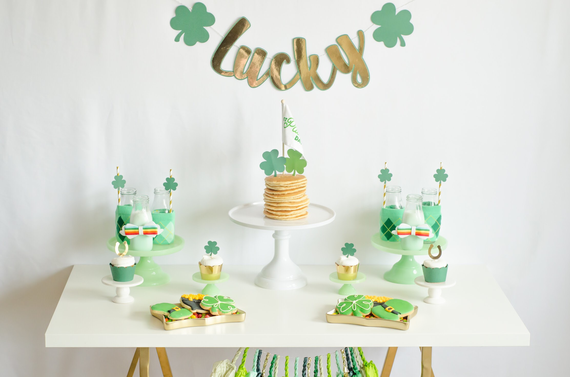 See all the green party details and how to create this Breakfast Bar spread for Saint Patricks Day on Mint Event Design www.minteventdesign.com #partyideas #partydecorations #breakfastfood #saintpatricksday #stpatricksday #pancakes