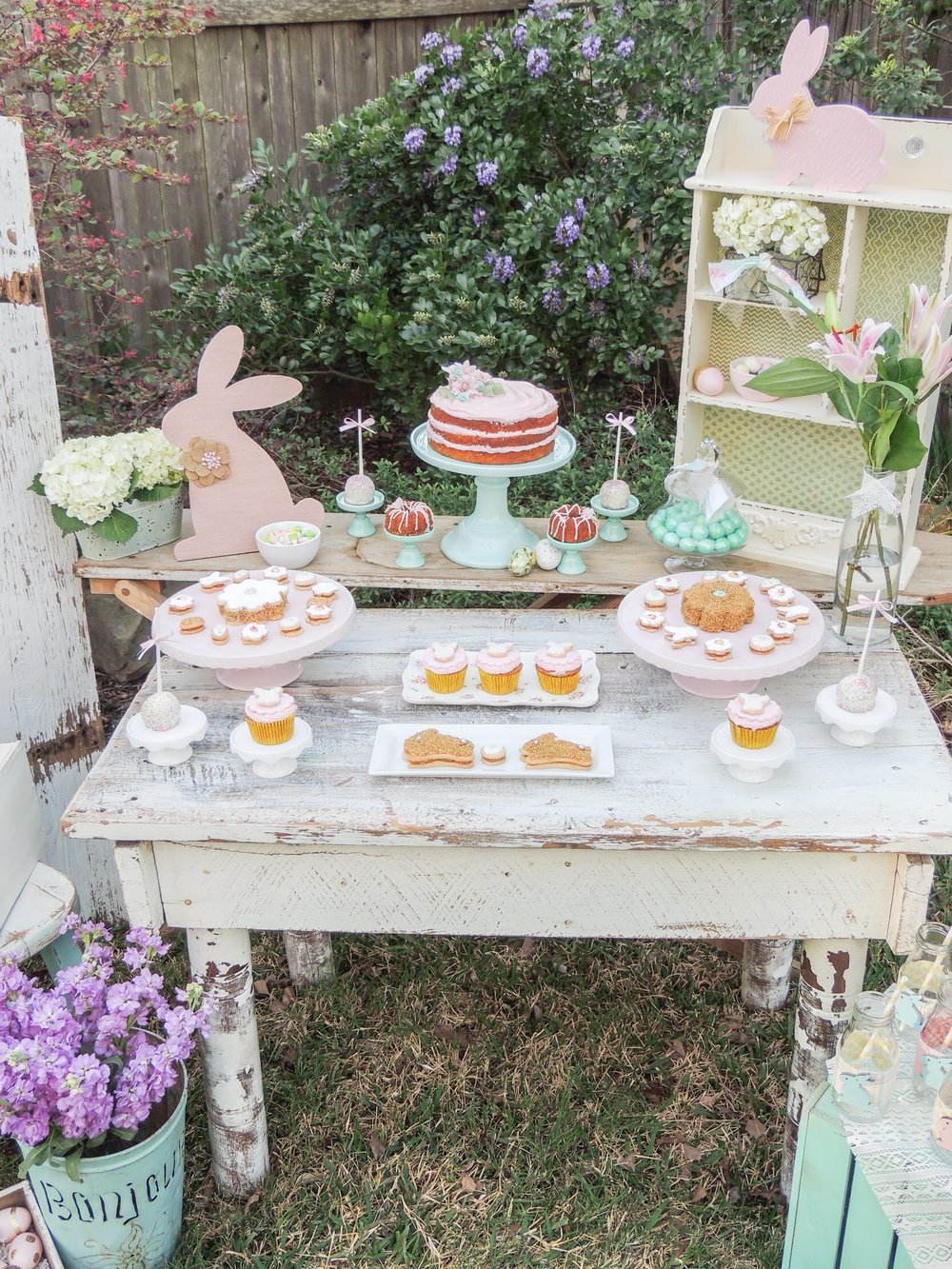 Gorgeously vintage and shabby chic Easter party in pretty pastels with a tiered carrot cake and mini bundt cakes. Styling by Austin Texas Party Planer Mint Event Design www.minteventdesign.com #eastertable #easterdecor #easterparty #partyideas #easterideas #easterdessert #shabbychic