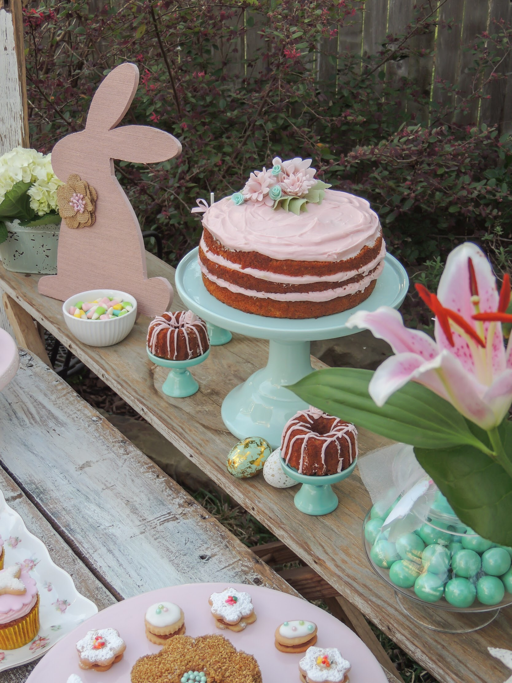 Sweet Easter baking ideas including a naked frosted carrot cake and mini bundt cakes. Styling by Austin Texas Party Planer Mint Event Design www.minteventdesign.com #eastertable #easterdecor #easterparty #partyideas #easterideas #shabbychic