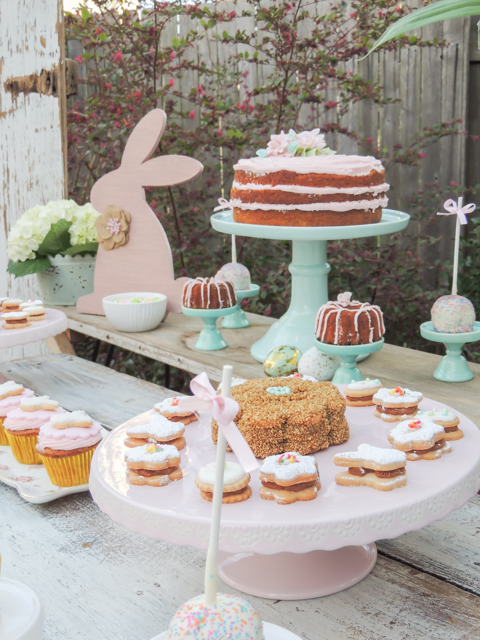 Pretty pink cake and desserts at this sweet Easter party. As seen on Mint Event Design www.minteventdesign.com #eastertable #easterdecor #easterparty #partyideas #easterideas