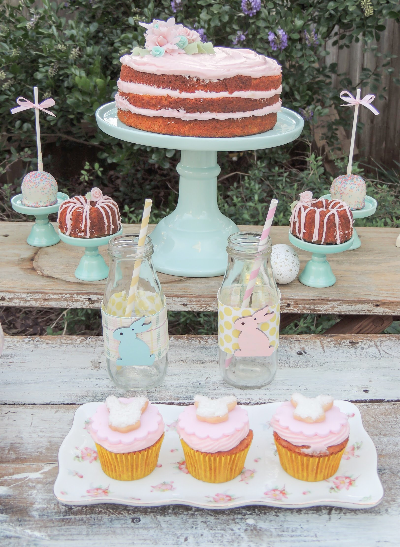 Vintage Easter celebration ideas with a frosted naked cake, bunny cupcakes and mini bundt cakes. As seen on Mint Event Design www.minteventdesign.com #eastertable #easterdecor #easterparty #partyideas #easterideas #shabbychic