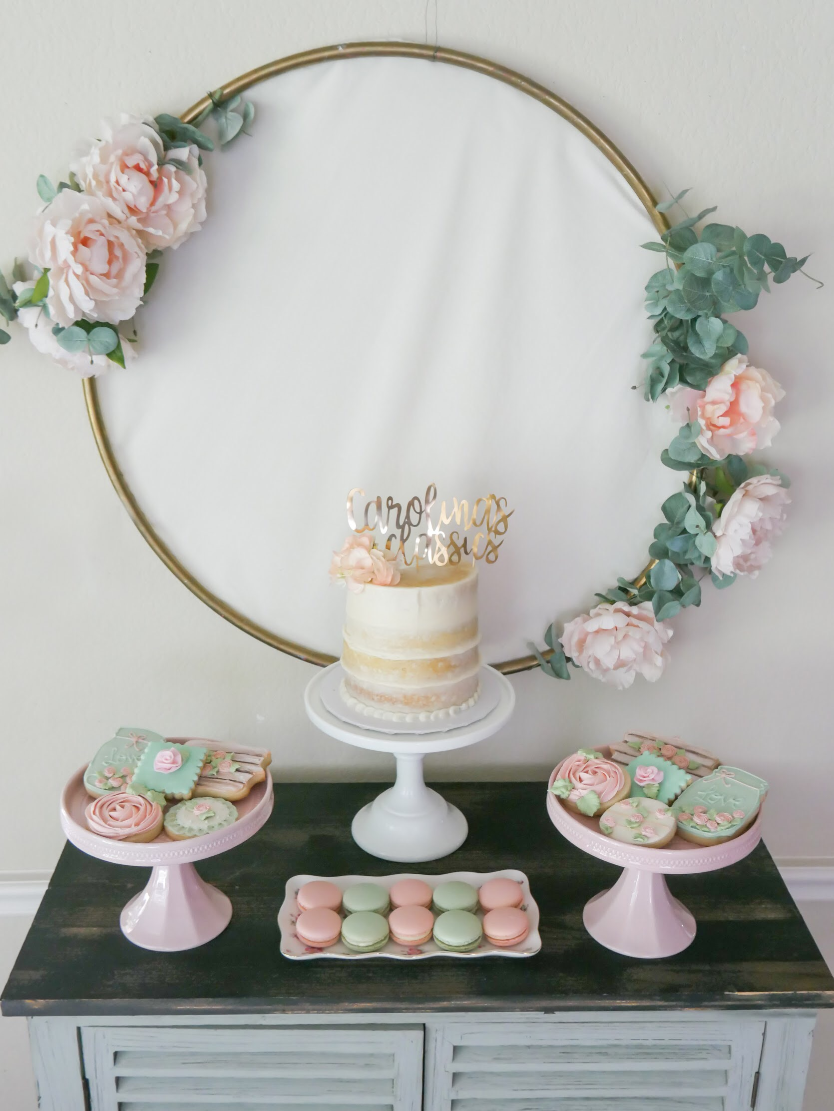 Create a quick and easy backdrop for your dessert table with a gold hoop that you add florals to. See all the garden party ideas from Mint Event Design www.minteventdesign.com #dessertparty #partytips #partyplanning #partyideas #diyparty #desserttable