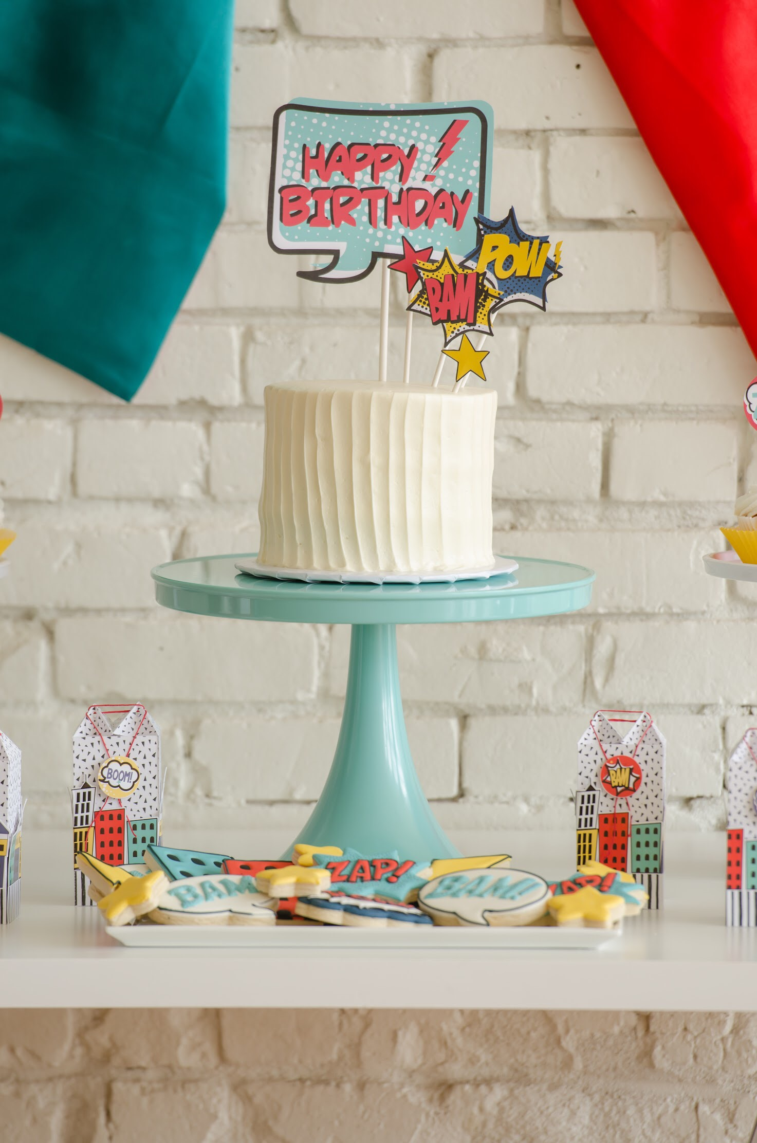 Free Printable Superhero cake topper and superhero party ideas from Mint Event Design