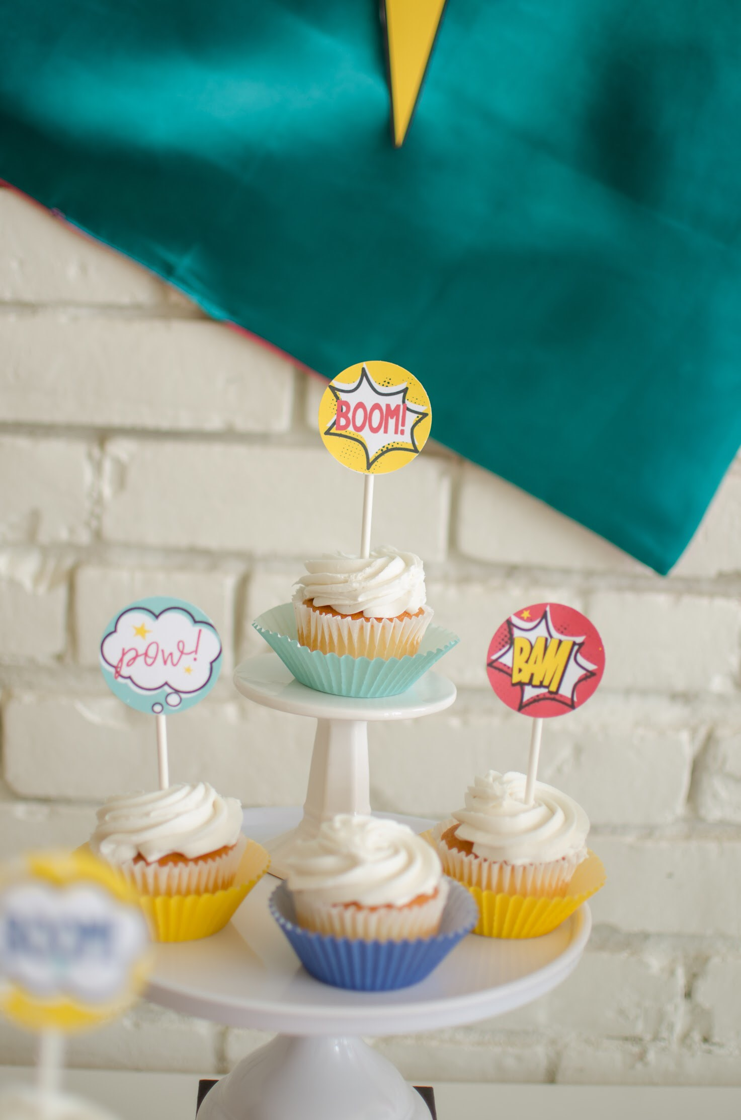 Cute cupcake toppers at a Superhero birthday! Fun ideas from Mint Event Design plus free printables!