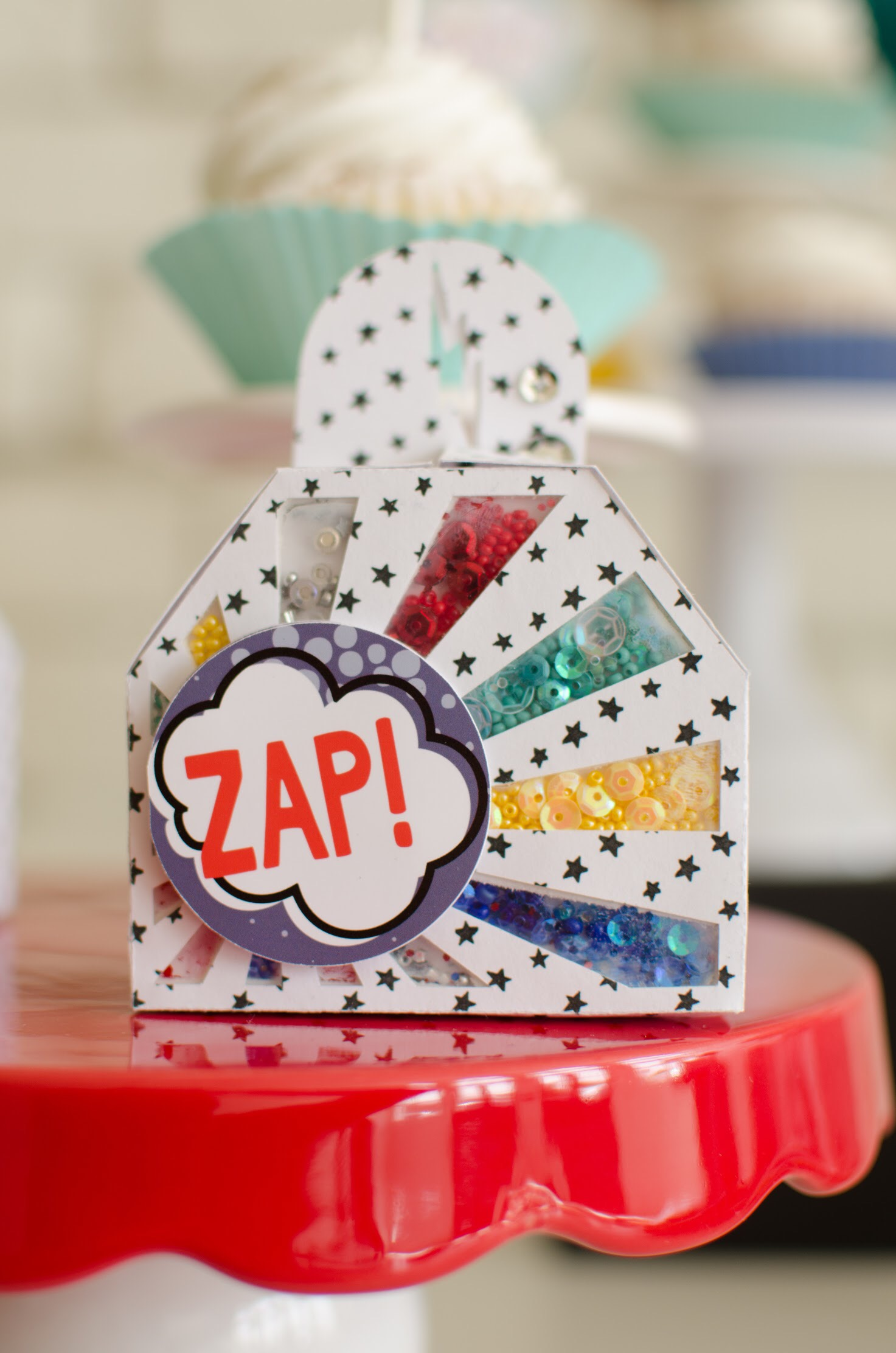 Cute favor boxes at this superhero birthday party