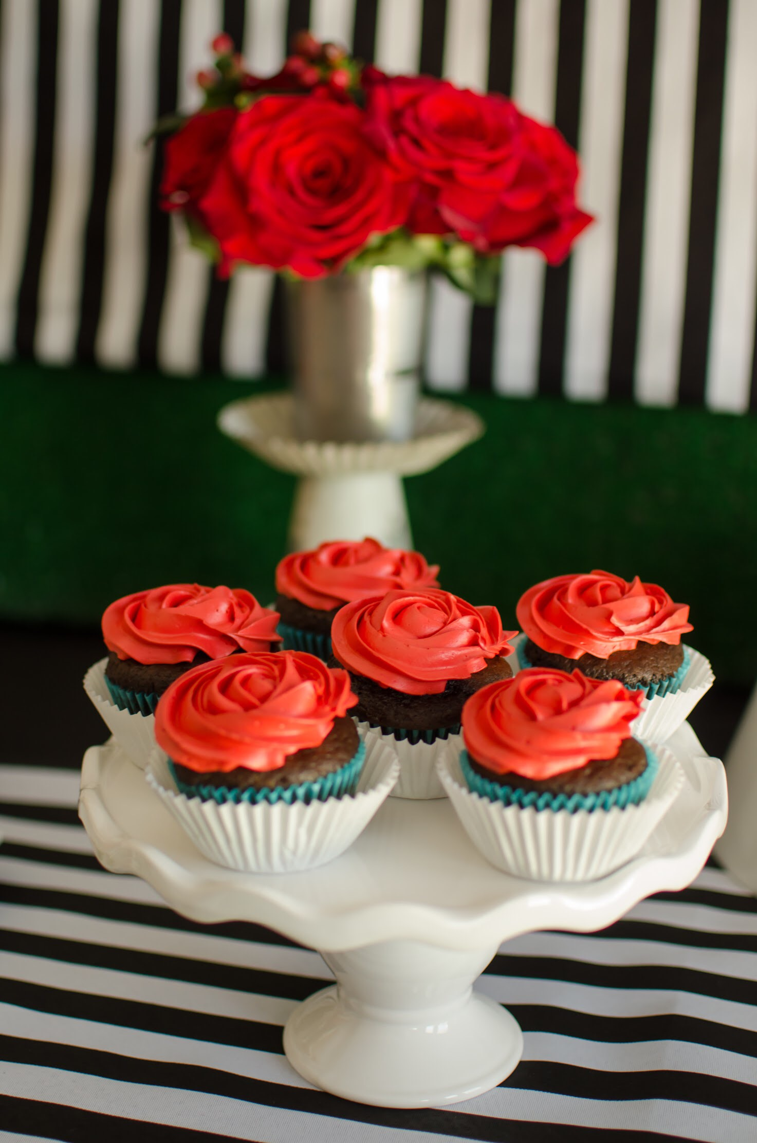Run for the Roses Kentucky Derby Cupcakes frosted with red roses. Styling by party planner Mint Event Design www.minteventdesign.com