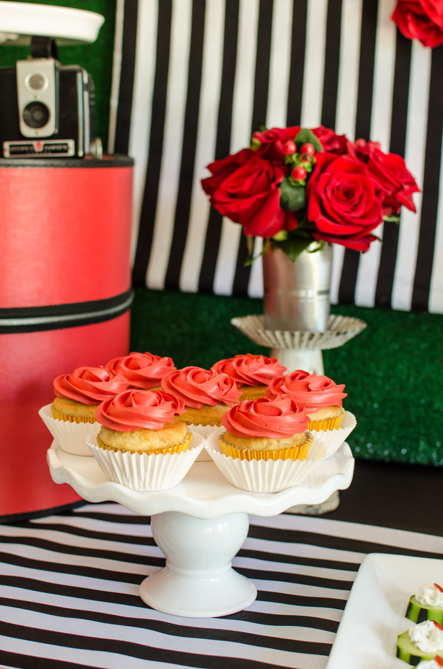 Red Party Ideas for a Kentucky Derby Party include cupcakes frosted to resemble red roses. From Mint Event Design www.minteventdesign.com
