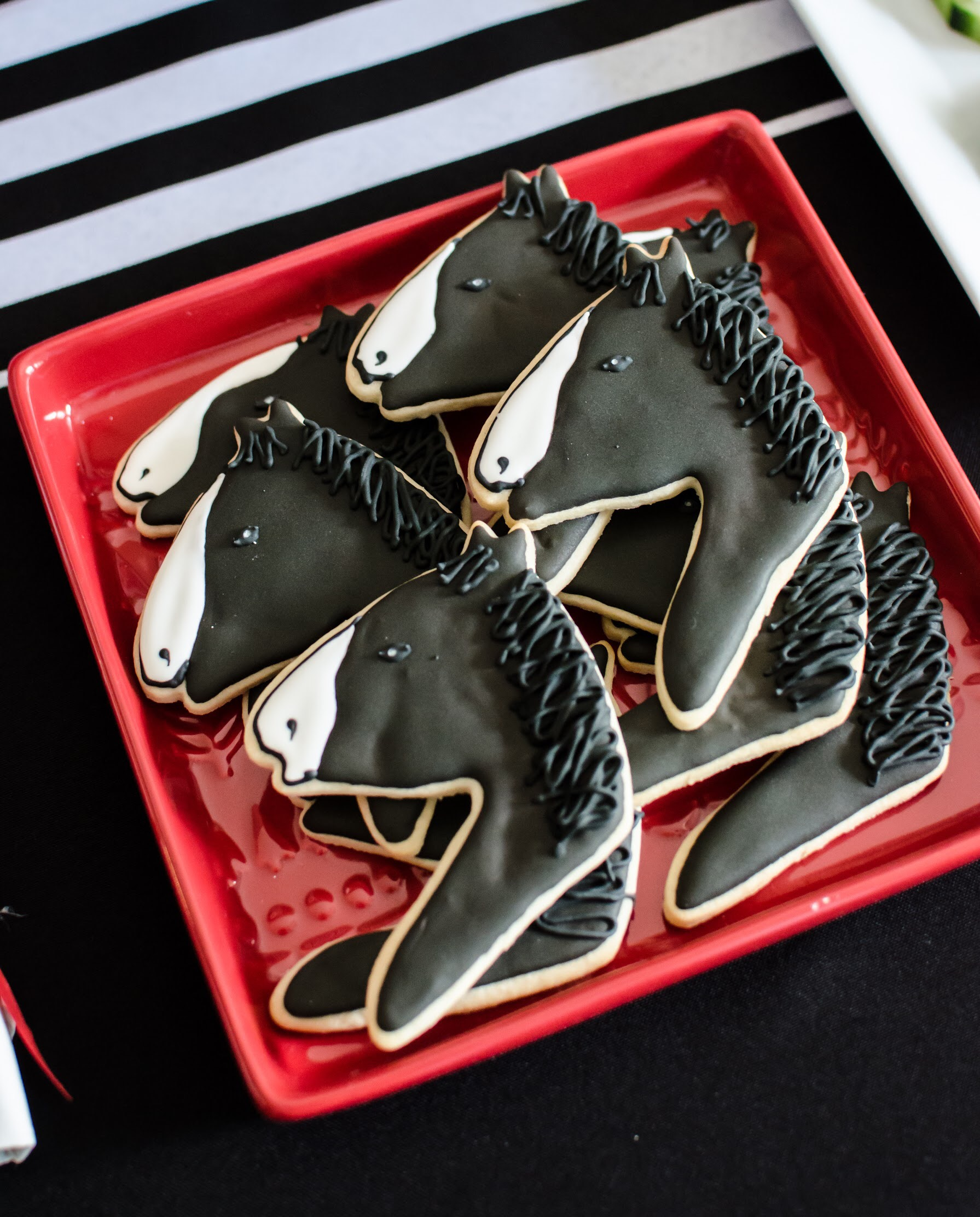 Horse shaped sugar cookies are the perfect party dessert for a Kentucky Derby party. By Mint Event Design www.minteventdesign.com