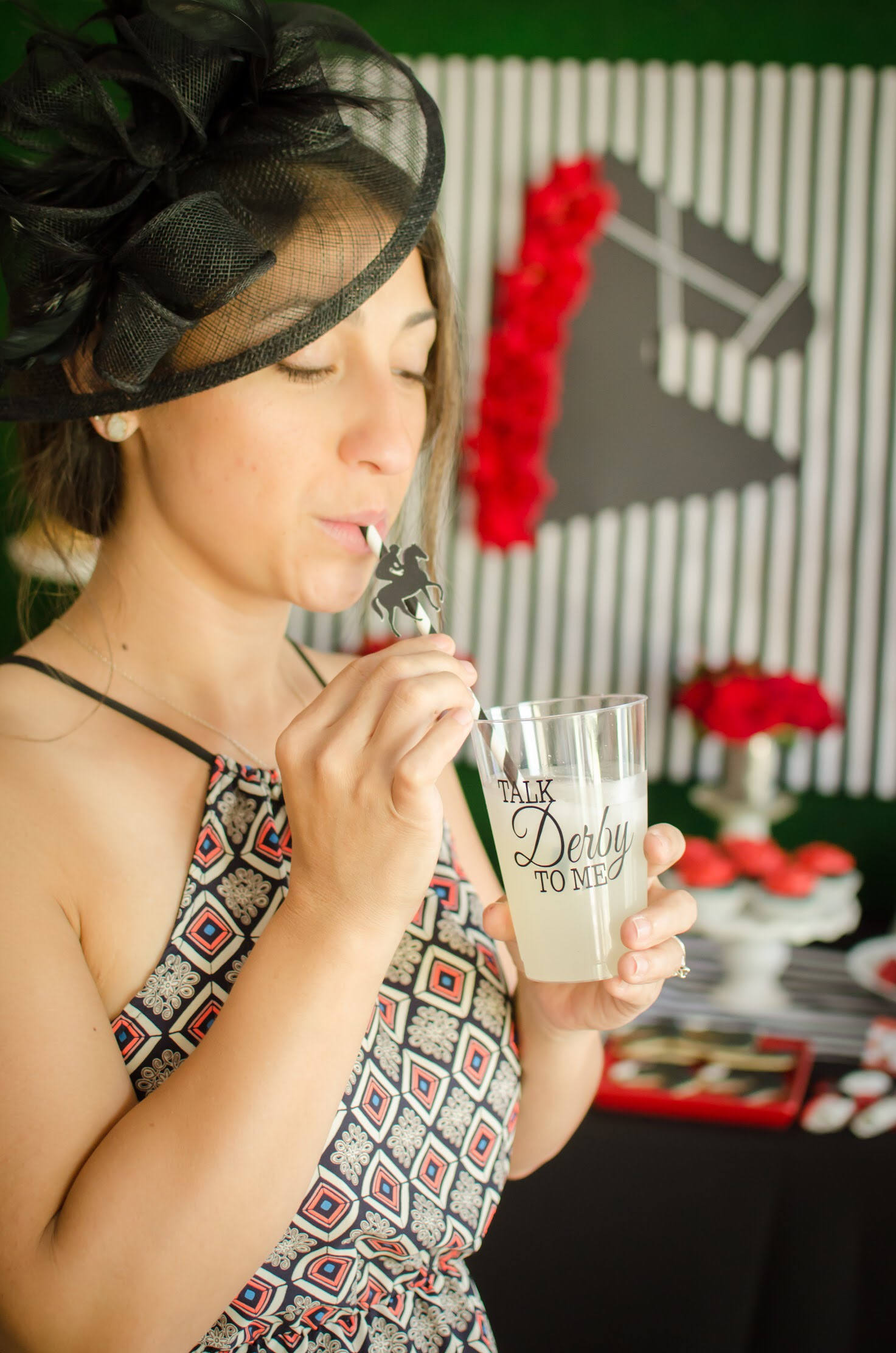 Red, black, and white Kentucky Derby Party ideas from Mint Event Design #kentuckyderbyparty #kentuckyderby #partyideas #derbyday #runfortheroses
