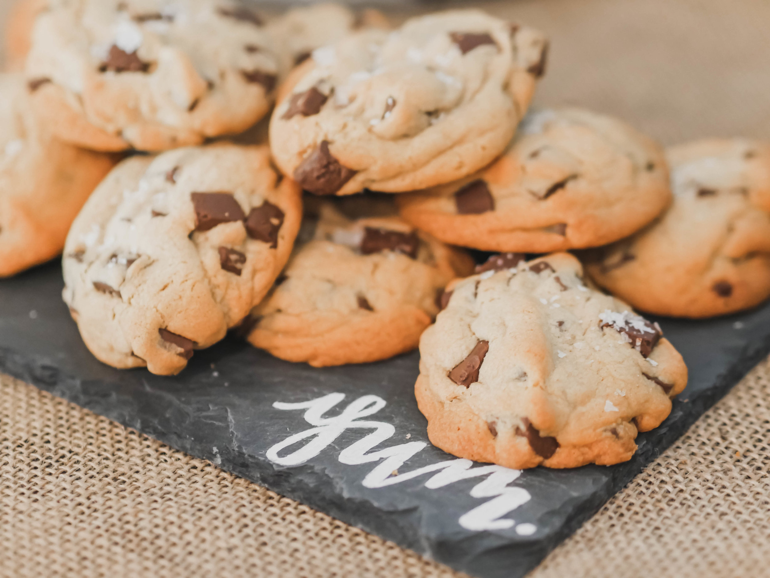 The yummiest of chocolate chip cookies for a One Smart Cookie Graduation Party - as seen on Mint Event Design www.minteventdesign.com #graduationparty #graduationpartyideas #partyideas #rusticpartyideas #partyinspiration #dessertbar #desserttable #cookies #chocolatechipcookies
