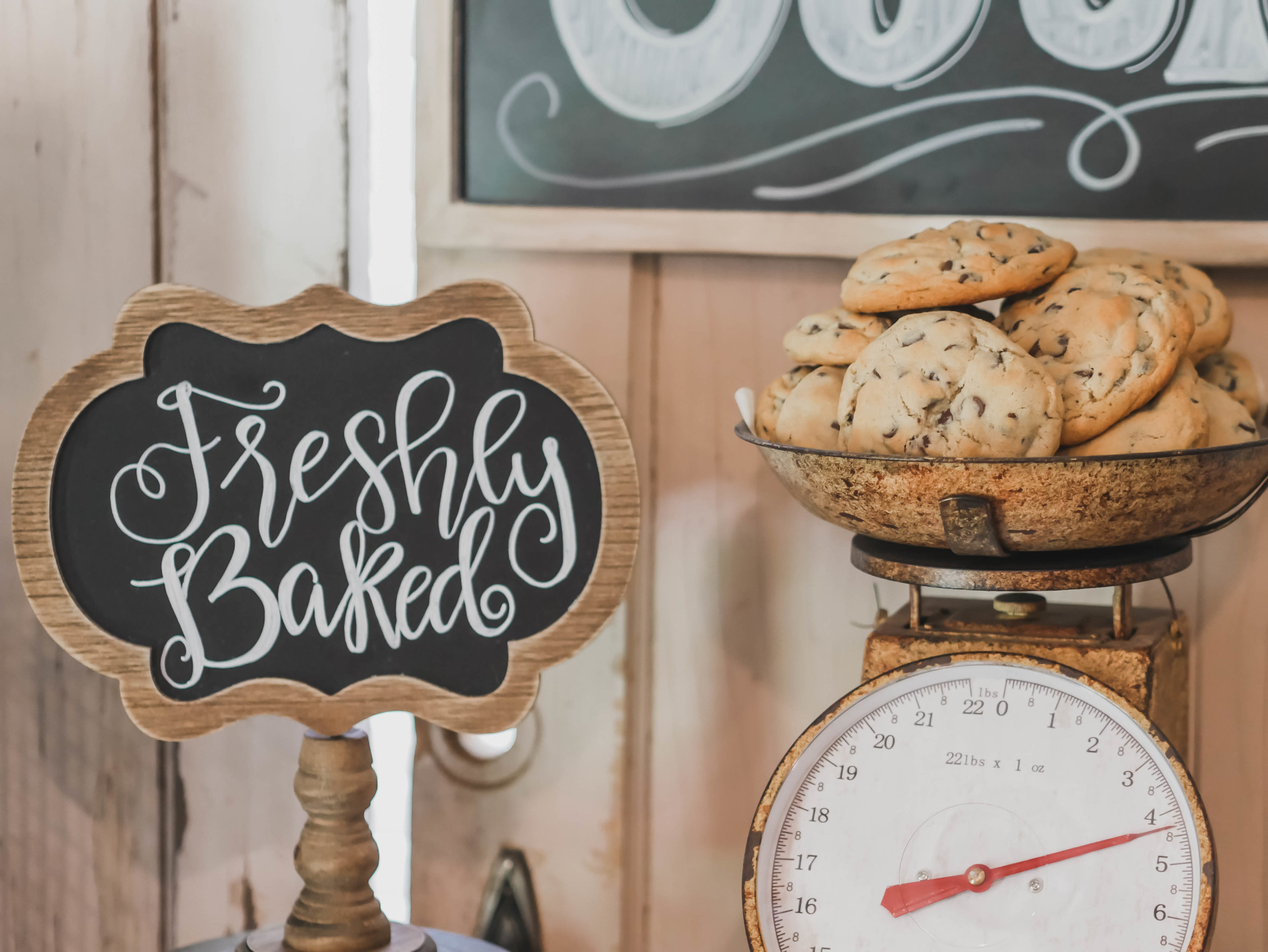 Freshly Baked Hand lettered chalkboard sign at a One Smart Cookie Graduation Party - as seen on Mint Event Design www.minteventdesign.com Rustic serving platters and galvanized metal create the perfect farmhouse feel at this One Smart Cookie Graduation party by Mint Event Design - party planner in Austin Texas www.minteventdesign.com #graduationparty #graduationpartyideas #partyideas #rusticpartyideas #partyinspiration #dessertbar #desserttable #chalkboardsigns