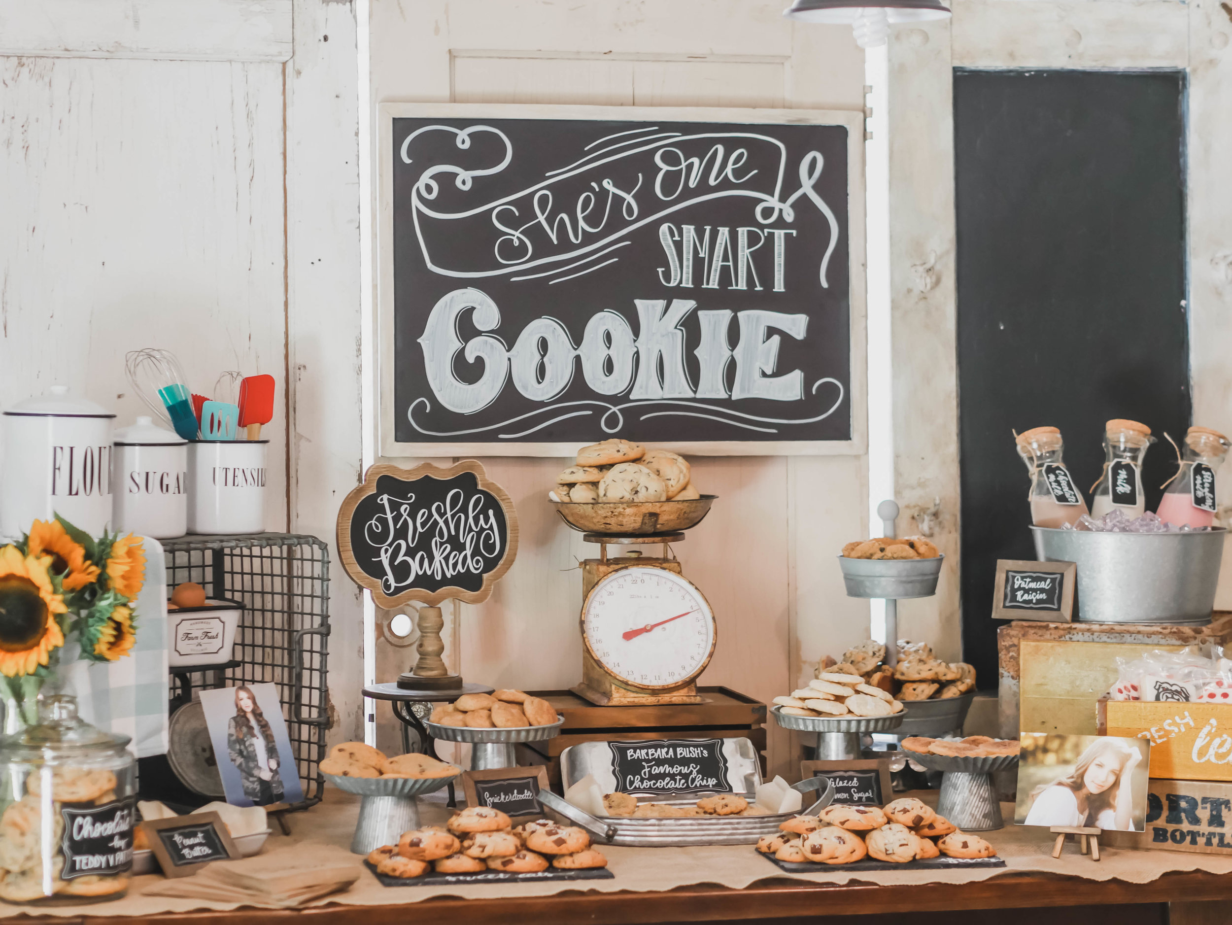 Hand lettered chalkboard signs were the perfect party decoration detail at this One Smart Cookie Graduation Party with vintage and rustic touches. Created by Mint Event Design www.minteventdesign.com #graduationparty #graduationpartyideas #partyideas #rusticpartyideas #partyinspiration #dessertbar #desserttable #chalkboardsigns