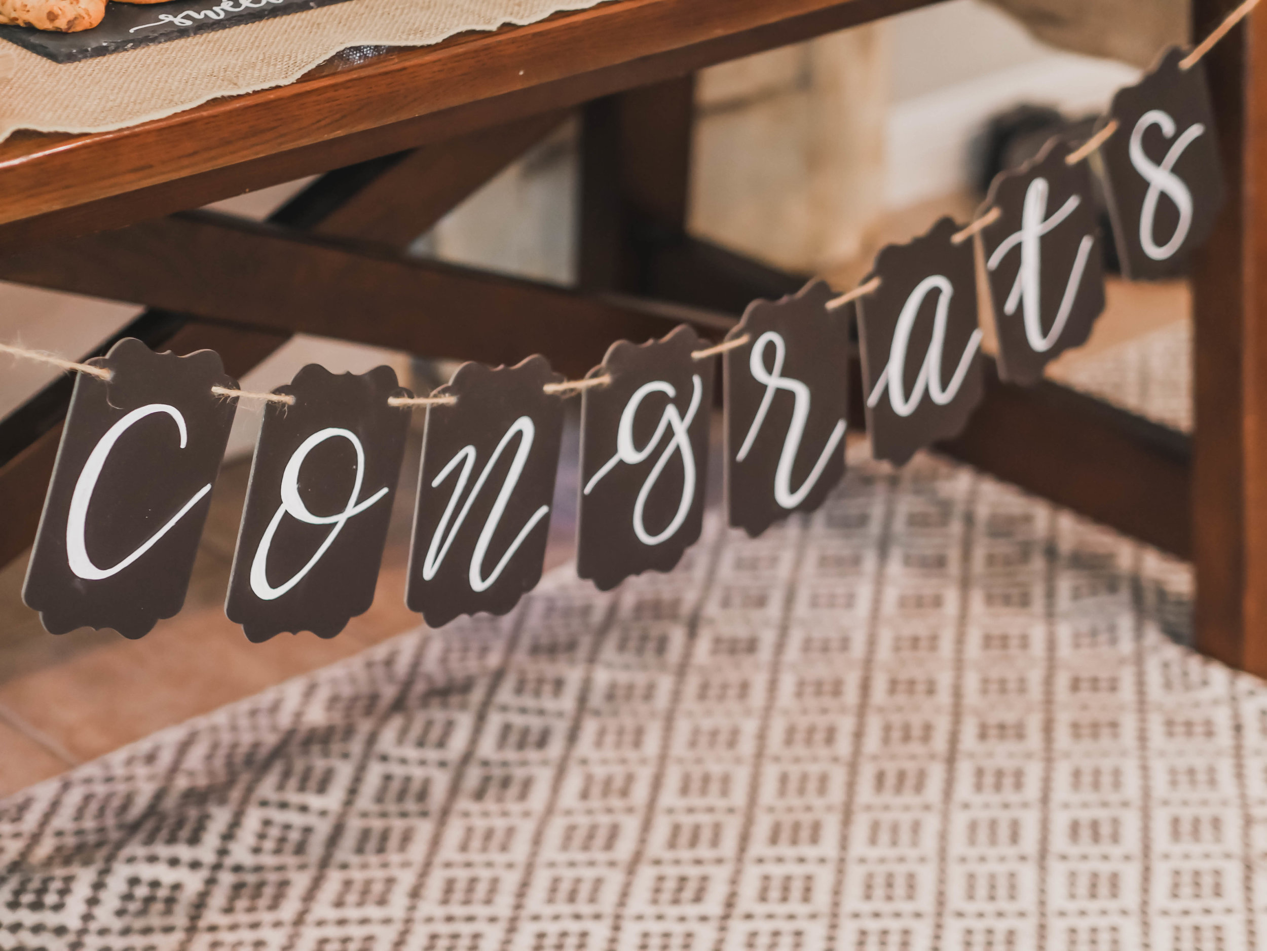Hand lettered Congrats Graduation Party Banner - as seen on Mint Event Design www.minteventdesign.com #graduationparty #graduationpartyideas #partyideas #rusticpartyideas #partyinspiration #partybanner
