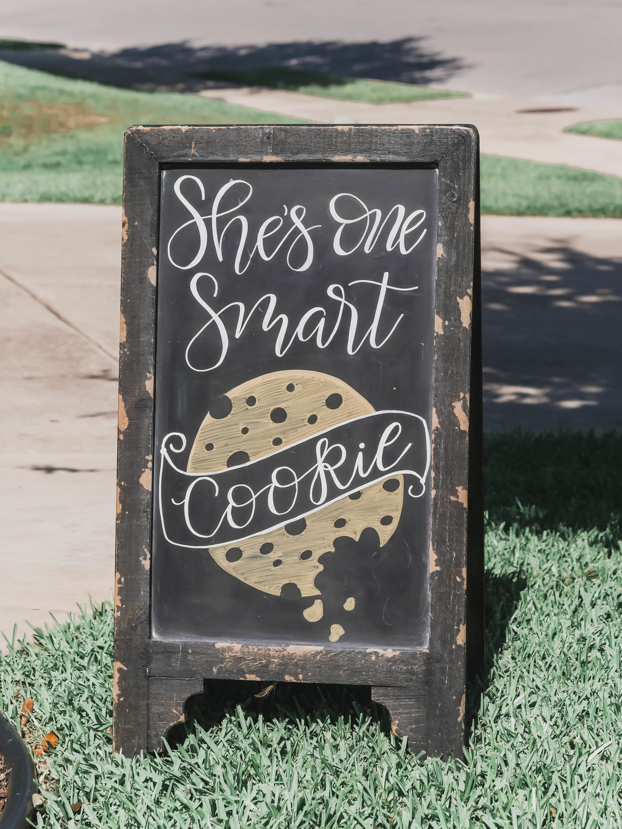 Hand lettered chalkboard sign - it's a One Smart Cookie Graduation Party Ideas from Mint Event Design www.minteventdesign.com Vintage style Cookie Bar Graduation Party Ideas from Mint Event Design - party planner in Austin Texas www.minteventdesign.com #graduationparty #graduationpartyideas #partyideas #rusticpartyideas #partyinspiration #chalkboardsigns