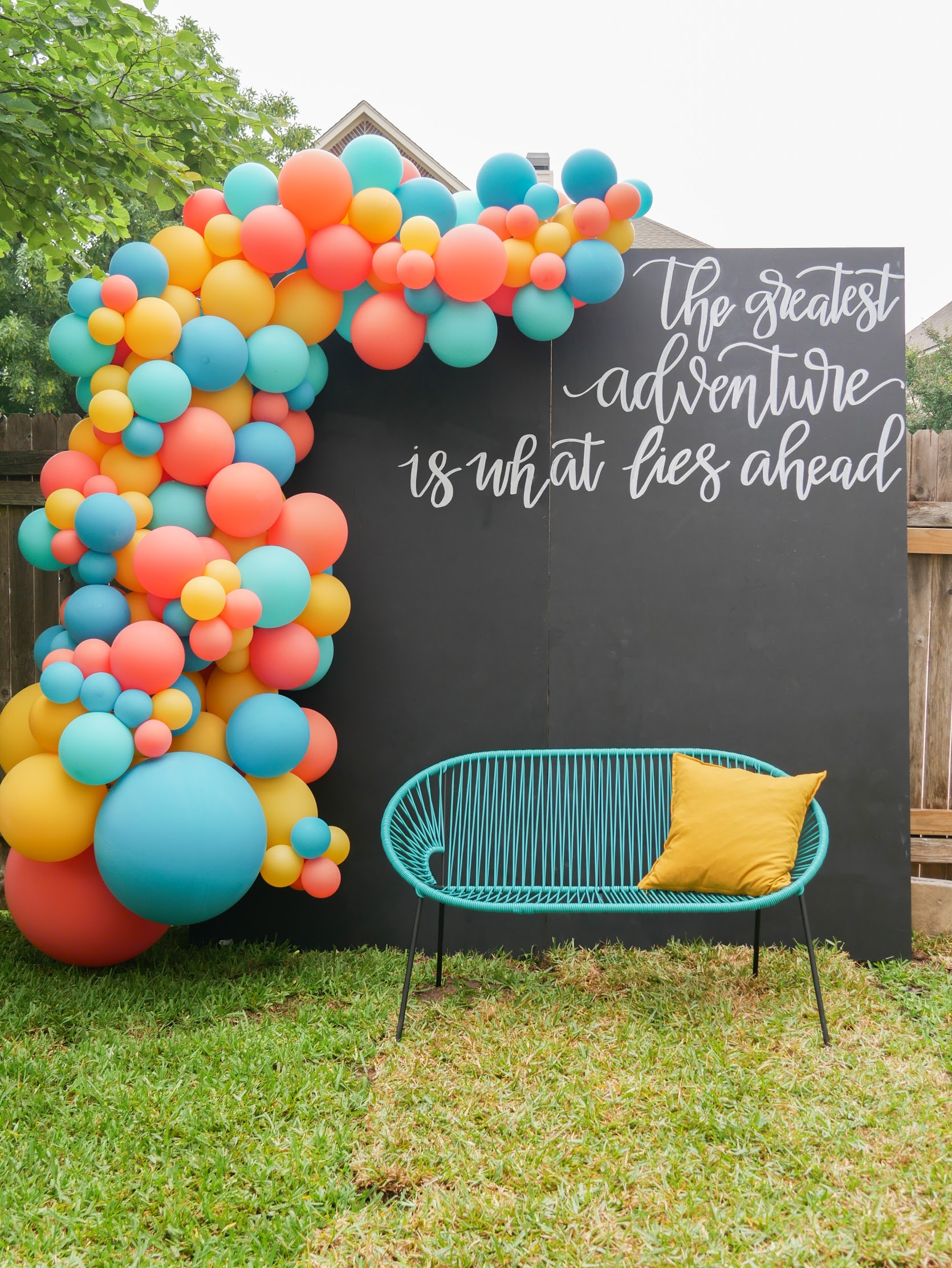 Graduation party photo booth ideas - create an oversized balloon garland with a DIY chalkboard backdrop that features a hand-lettered quote. See more from this Grad Party on Mint Event Design www.minteventdesign.com #graduationparty #graduationpartyideas #graduation #gradparty #gradpartyideas #partyballoons #balloongarland #photobooth #photobackdrop
