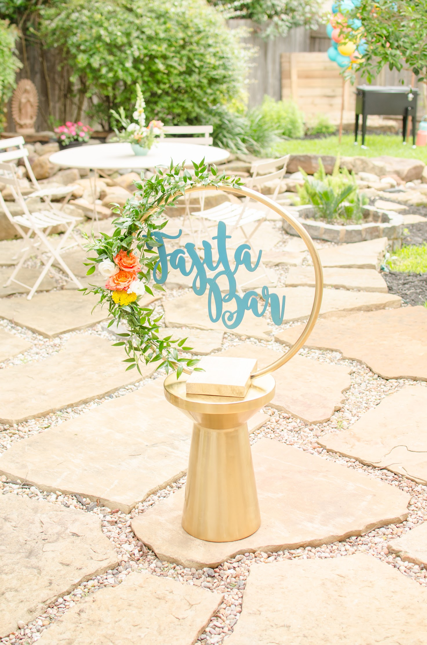 DIY Fajita Bar Party Sign - spray paint a hula hoop gold or use a floral gold hoop, add florals and a decorative lettered sign. See more from this Grad Party on Mint Event Design www.minteventdesign.com #graduationparty #graduationpartyideas #graduation #gradparty #gradpartyideas #partydecor #floralgarland #fiestaparty