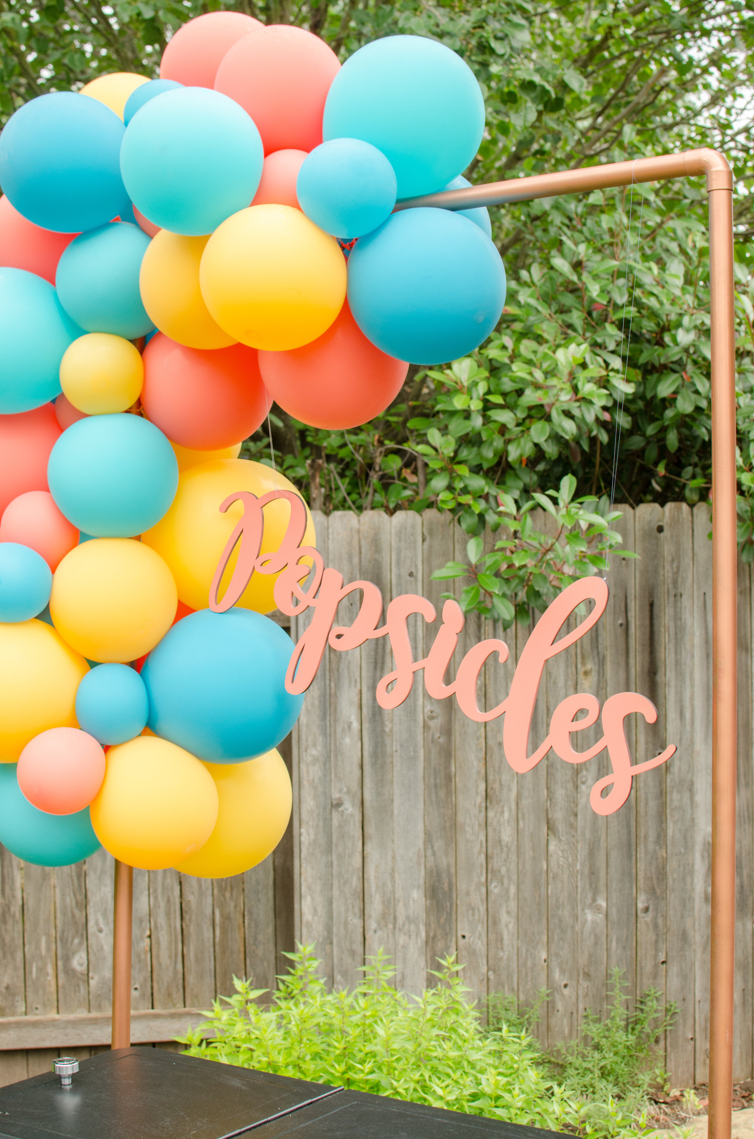 Create a popsicle station with creative signage for a summer graduation party. See more from this Grad Party on Mint Event Design www.minteventdesign.com