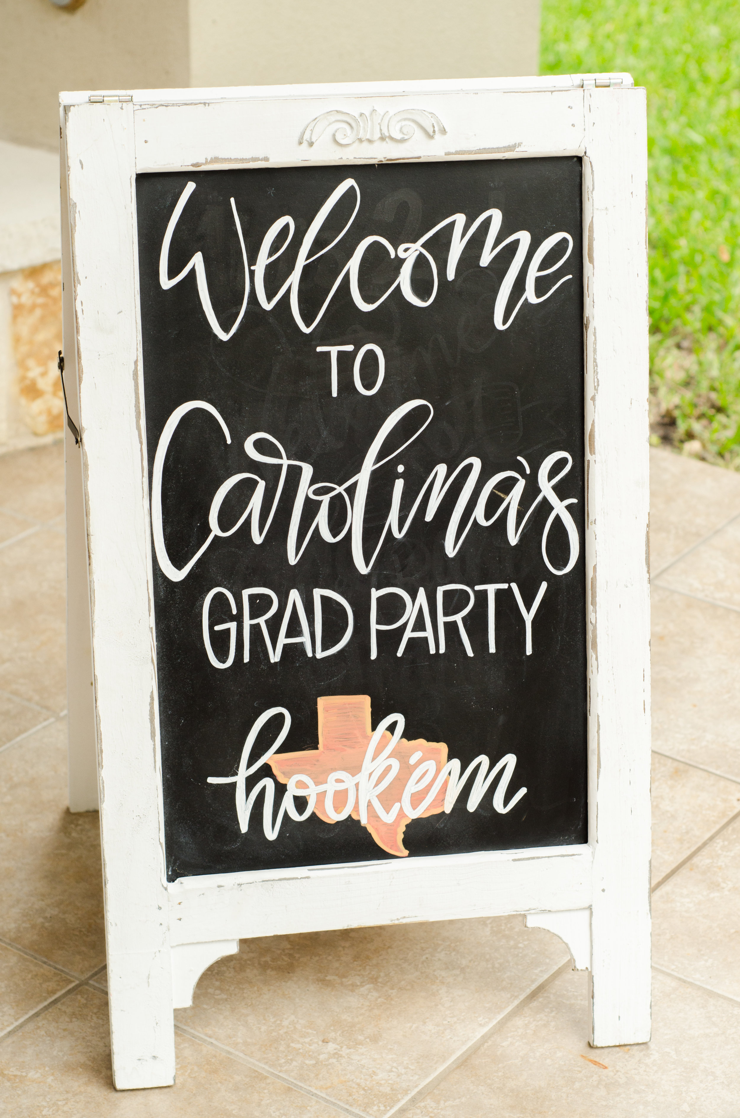 Hand-lettering is always a nice touch at any party! This high school grad party is so fun with a personalized chalkboard welcome sign. See more from this Grad Party on Mint Event Design www.minteventdesign.com #graduationparty #graduationpartyideas #graduation #gradparty #gradpartyideas #chalkboardsigns