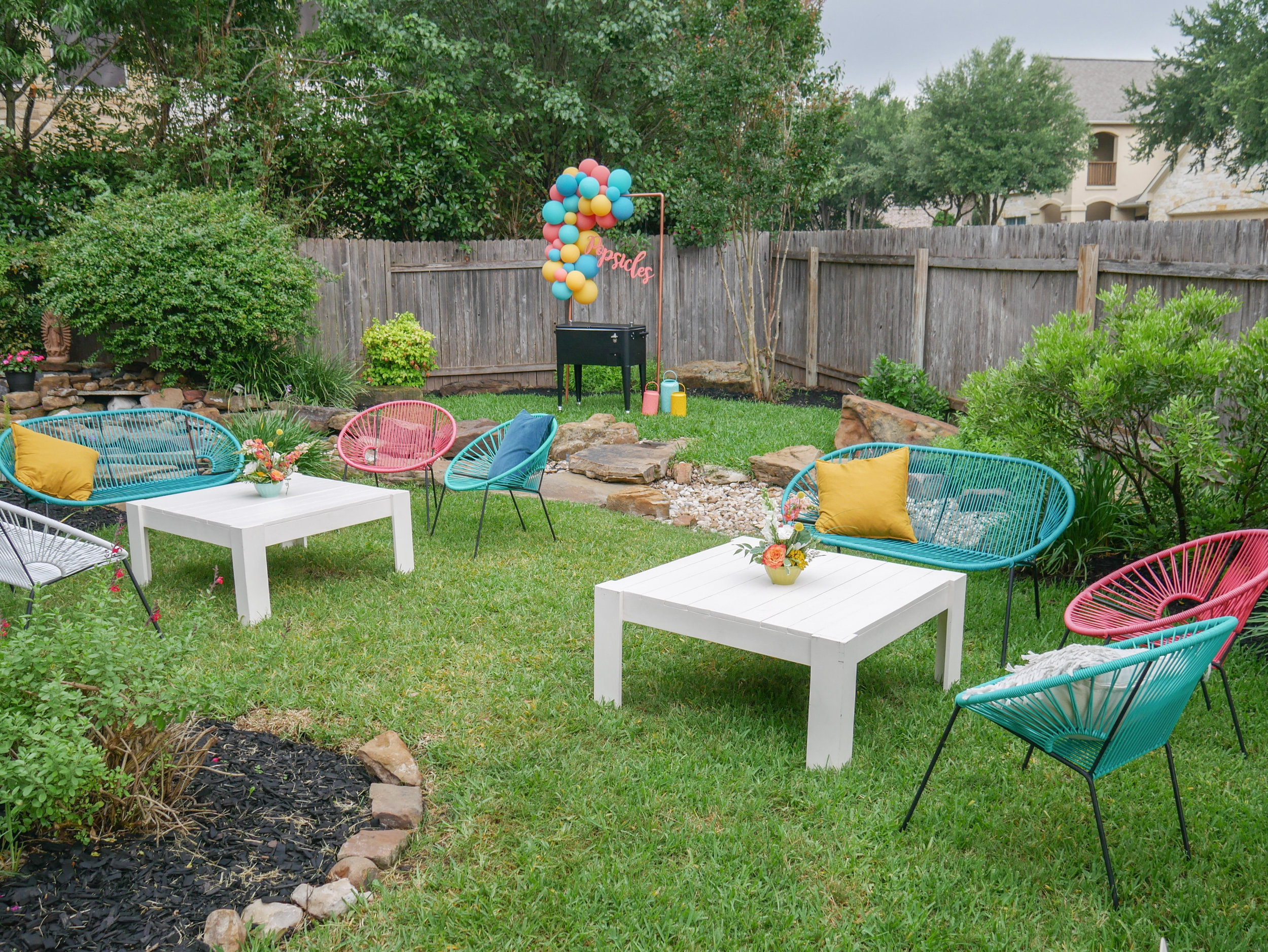 Modern Grad Party Ideas for outdoor entertaining include fun and colorful chairs. See more from this Grad Party on Mint Event Design www.minteventdesign.com #graduationparty #graduationpartyideas #graduation #gradparty #gradpartyideas #outdoorentertaining #outdoordining